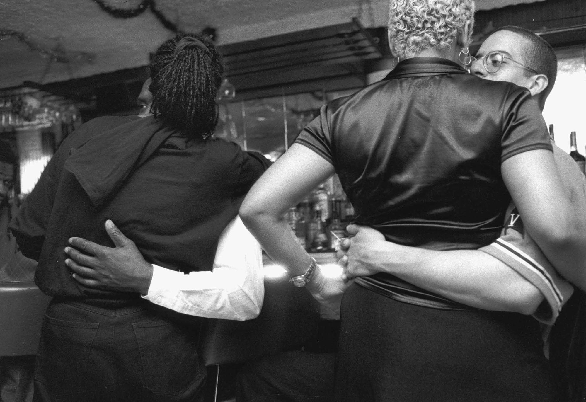 Gerald Cyrus, Two Couples, Arms Around, St. Nick's Pub, 1998. Gelatin silver print. Courtesy of the artist.
