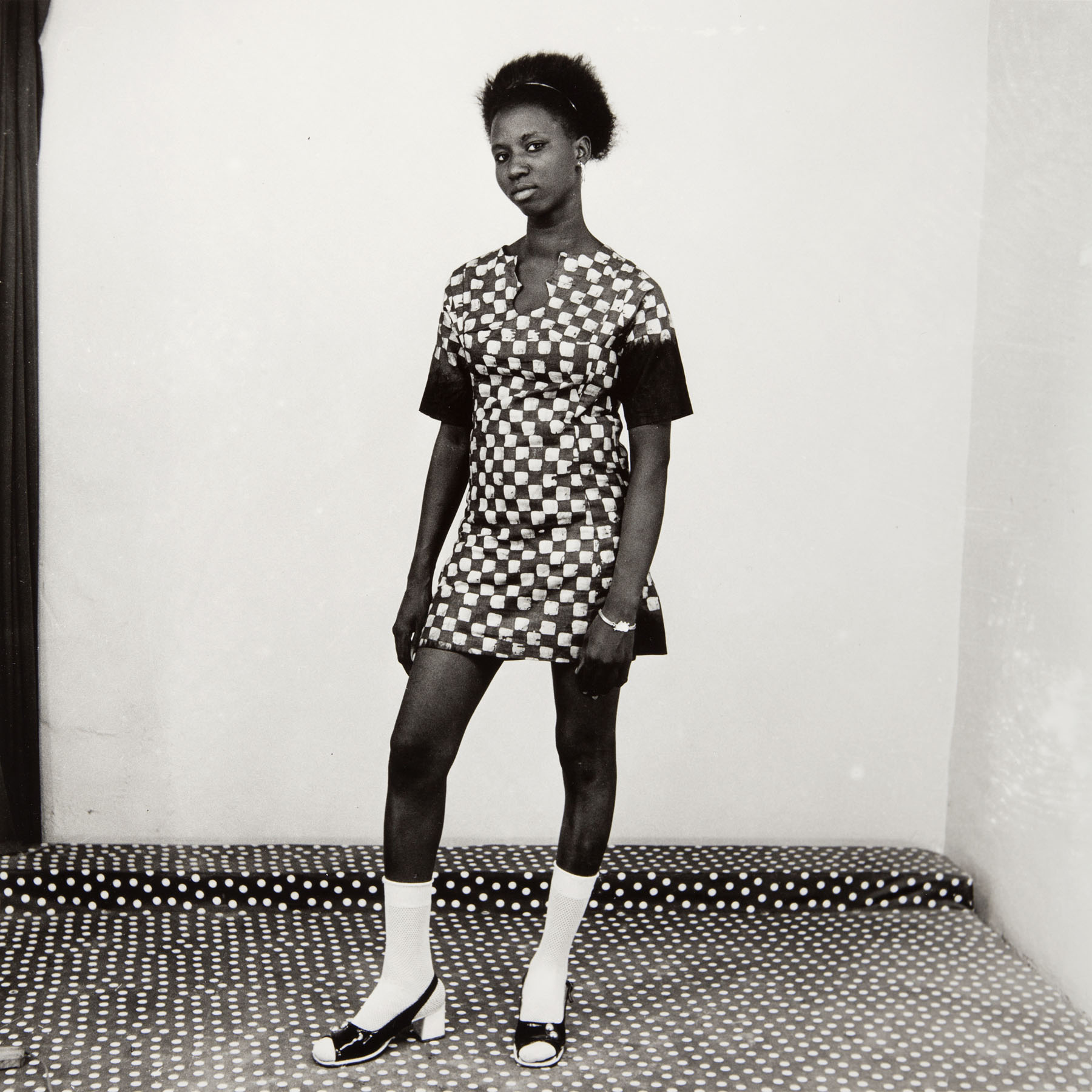 Malick Sidibé, Woman in a Checkered Dress, 1971. Gelatin silver print. © Malick Sidibé / Gwinzegal / diChroma photography