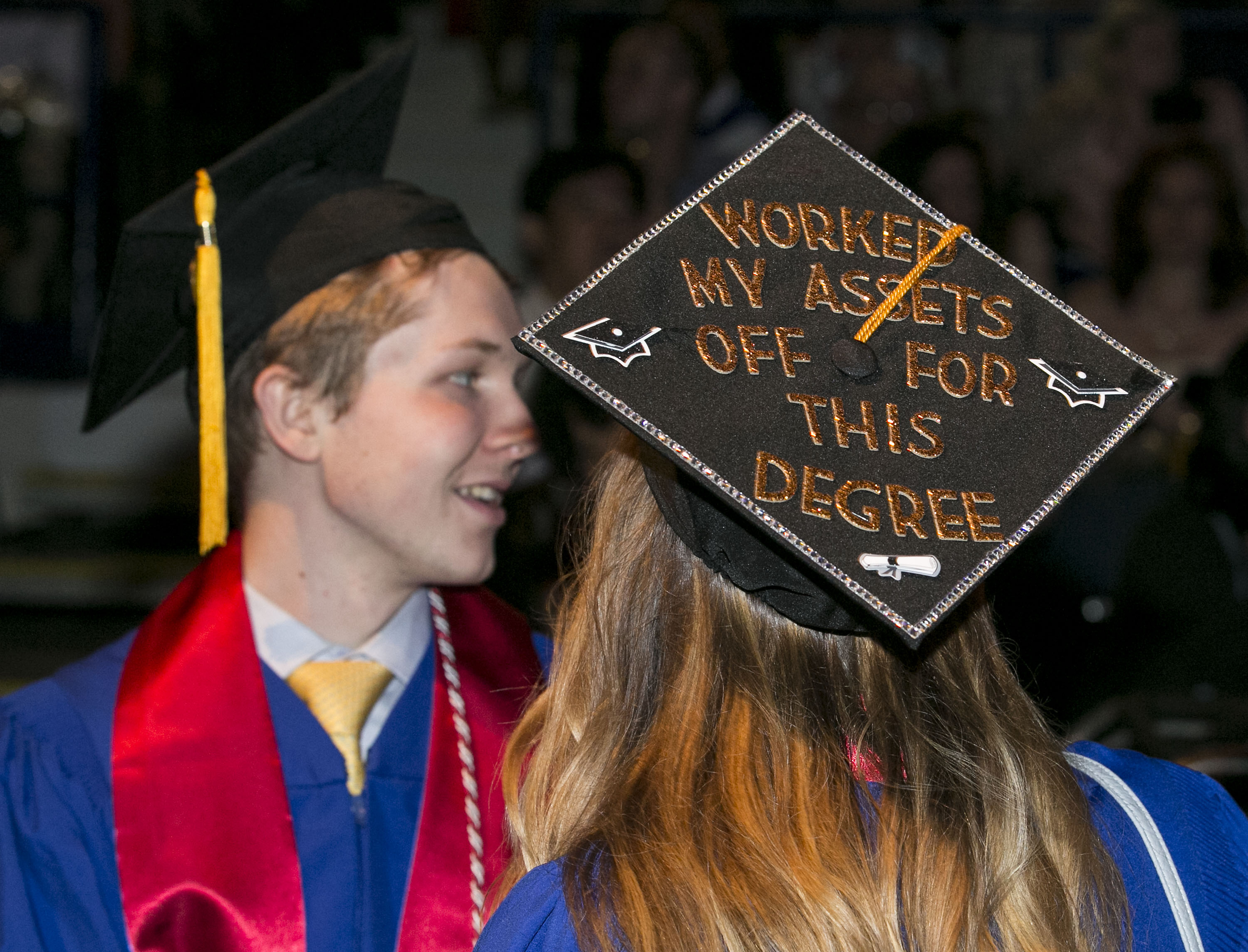 Decorated mortarboards as students make their way into the arena Sunday, June 11, 2017, during the DePaul University Driehaus College of Business commencement ceremony at the Allstate Arena in Rosemont, IL. (DePaul University/Jamie Moncrief)