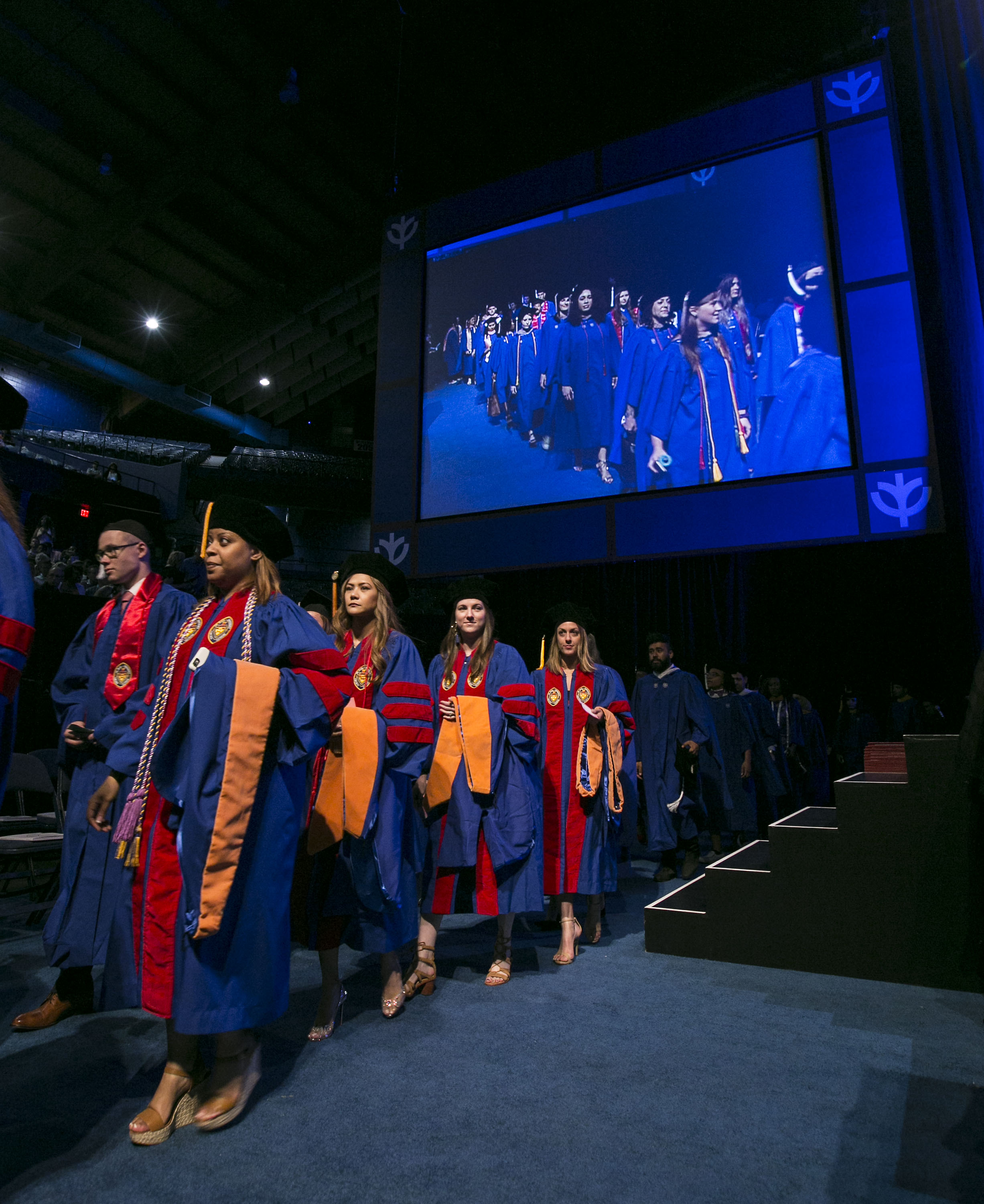 Students make their way into the Allstate Arena Sunday, June 11, 2017, for the DePaul University College of Science and Health and College of Liberal Arts and Social Sciences commencement ceremony in Rosemont, IL. (DePaul University/Jamie Moncrief)