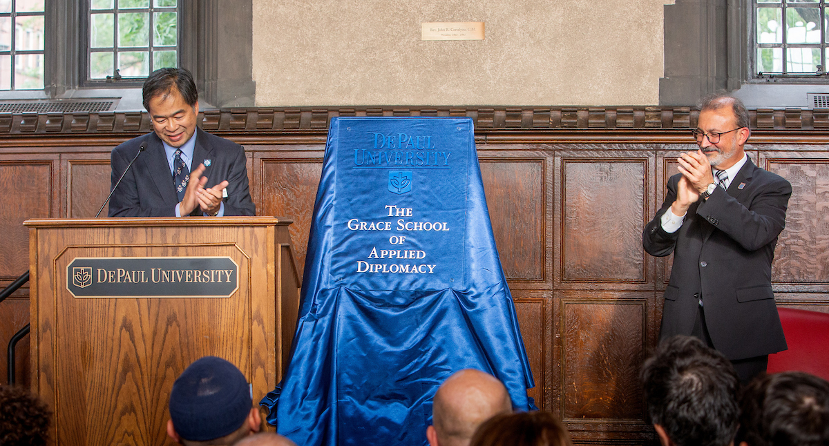A. Gabriel Esteban, Ph. D., left, president of DePaul University​ and Guillermo Vásquez de Velasco, dean of the College of Liberal Arts and Social Sciences, inaugurate The Grace School of Applied Diplomacy. (DePaul University/Randall Spriggs)​​​​