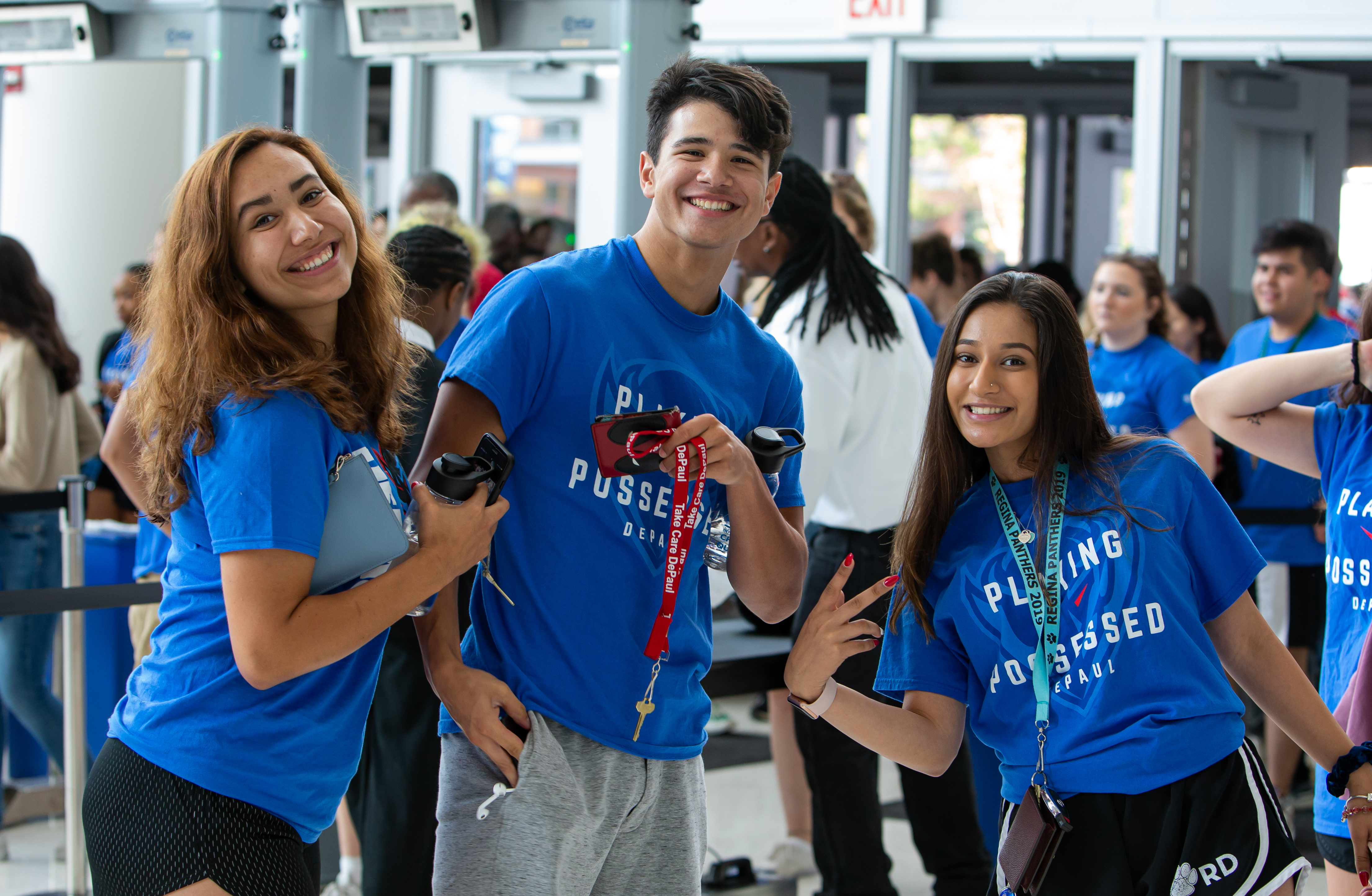 New DePaul students stop for a photo on their way in to Wintrust Arena for the first student convocation. (DePaul University/Randall Spriggs)
