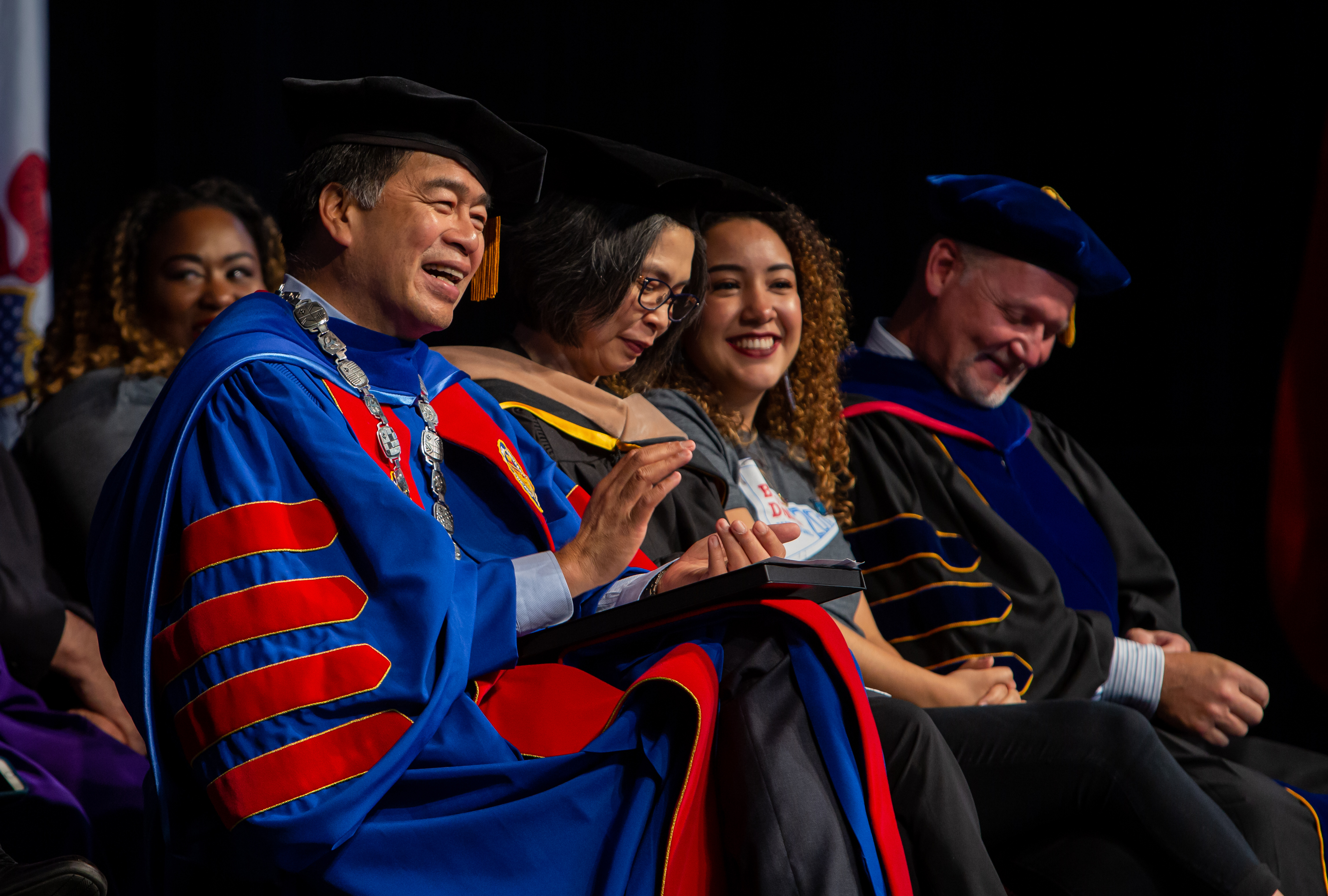 Left to right, A. Gabriel Esteban, Ph.D., president of DePaul University, his wife Josephine, Gisselle Cervantes, SGA president, and Gene Zdziarski, vice president for Student Affairs, enjoy a moment of humor during the ceremony. (DePaul University/Randall Spriggs)