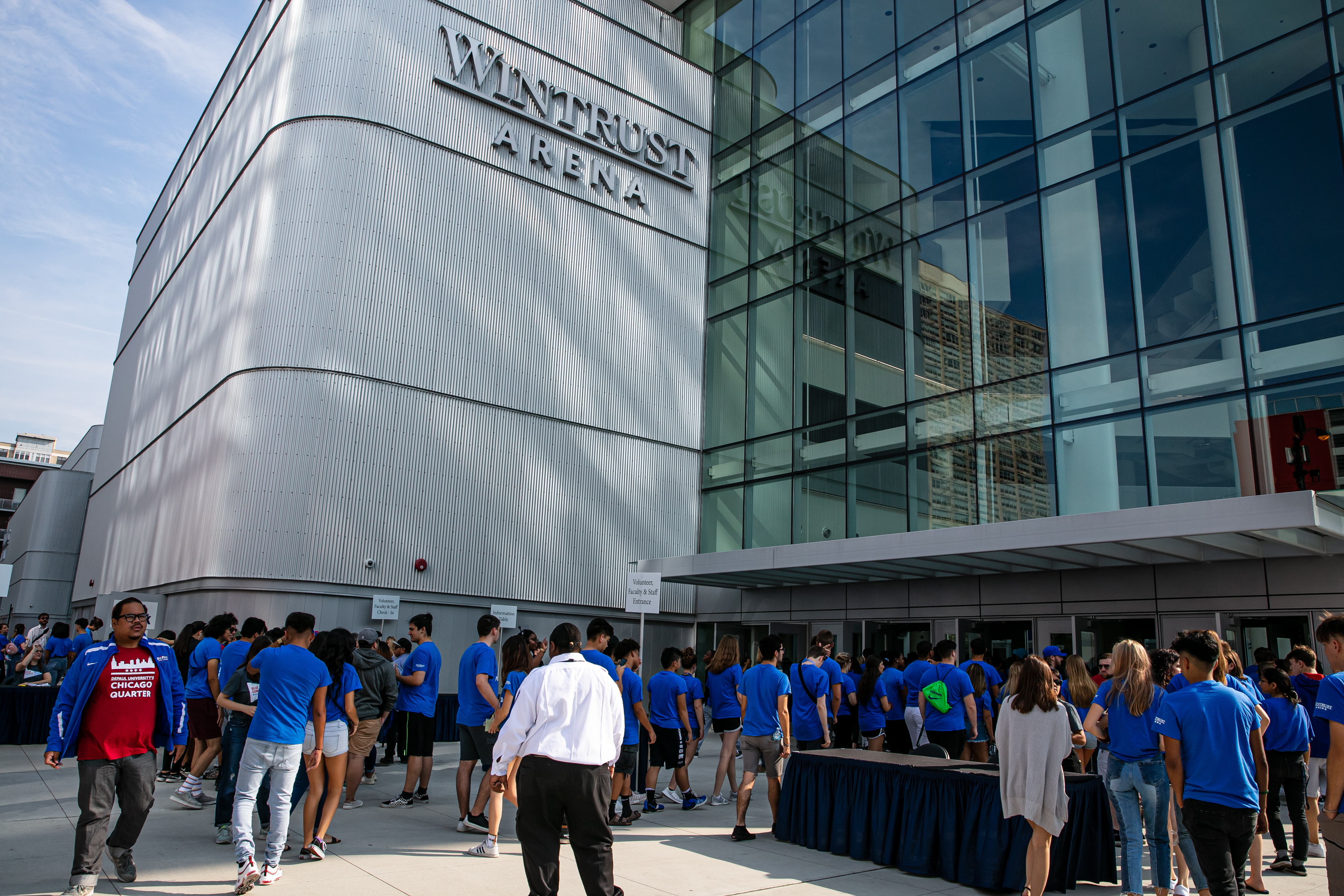 New DePaul students, faculty and staff in Discover and Explore Chicago classes, and faculty, staff and student volunteers file into Wintrust Arena for the new student convocation, Tuesday, Sept. 10th, 2019. (DePaul University/Randall Spriggs)
