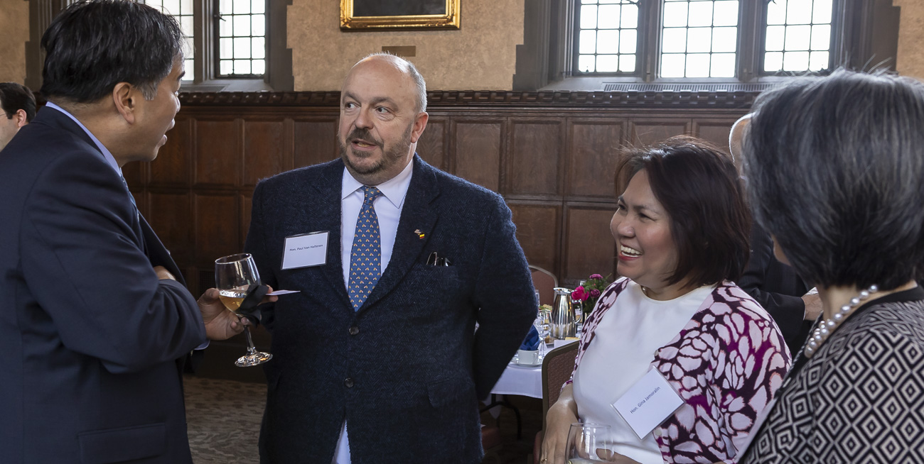 Paul	Van Halteren of Belgium, center left, and Gina Jamoralin of the Philippines talk with A. Gabriel Esteban, Ph.D., president of DePaul University, and his wife Josephine. (DePaul University/Jeff Carrion)