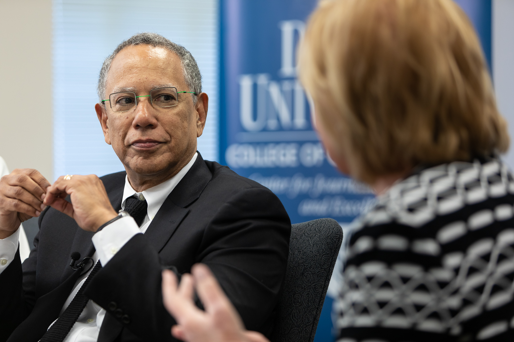 Dean Baquet, executive editor of the The New York Times, talks with Carol Marin, co-director of the Center for Journalism Integrity and Excellence, and College of Communication journalism students on Thursday, April 25. (DePaul University/Jeff Carrion)