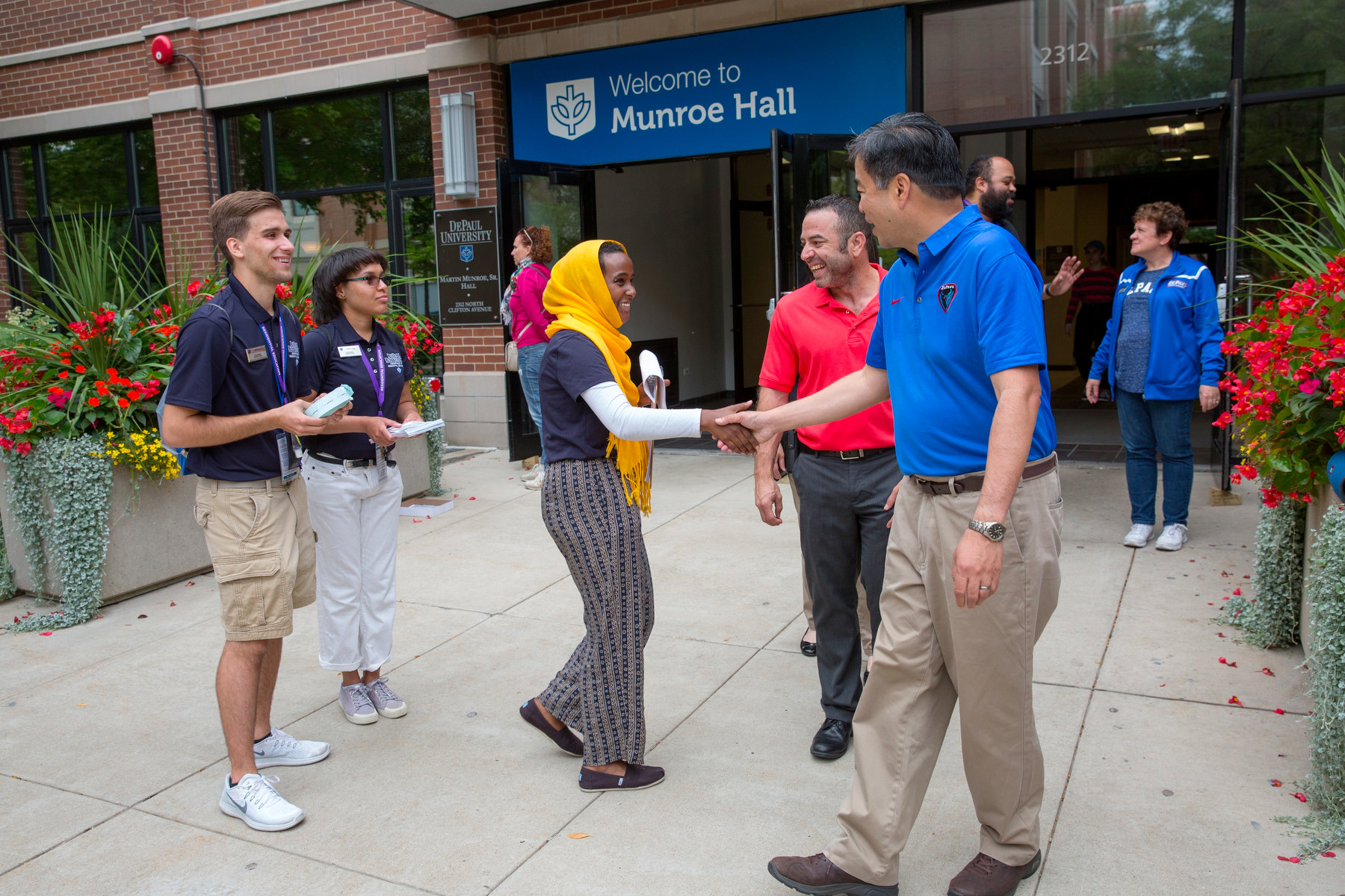 Esteban greets students during Move-In