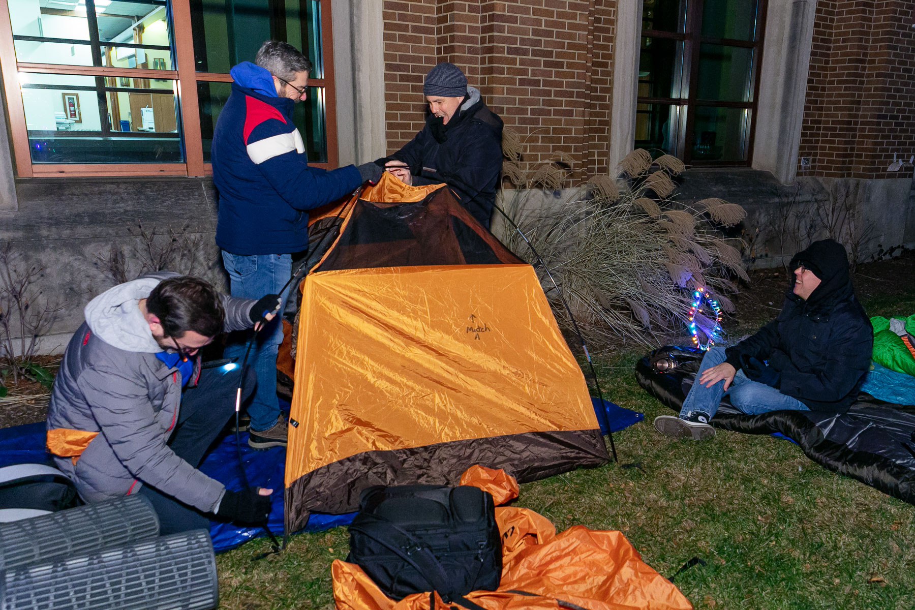 About 75 people braved the wind and cold to sleep outside overnight. Chicago's wind chill factor made it feel like it was 23 degrees, coming in a close second to the chill in Kharkiv, Ukraine, which also held a sleep out that night. (DePaul University/Randall Spriggs)