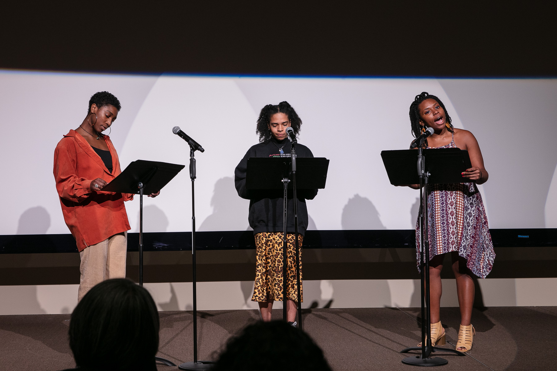 Students from The Theatre School performed a spoken word piece reflecting on Black History Month. From left to right, Jasmine Rush, Gabriella Mendoza and Kidjie Boyer. (DePaul University/Randall Spriggs)