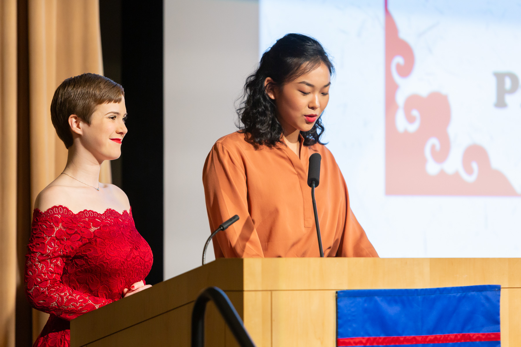 Amanda Stocchetti, president of the DePaul Chinese Studies Association, left, and Yi (Joy) Fang, president of the DePaul Chinese Students and Scholars Association, welcome guests to the event. (DePaul University/Randall Spriggs)