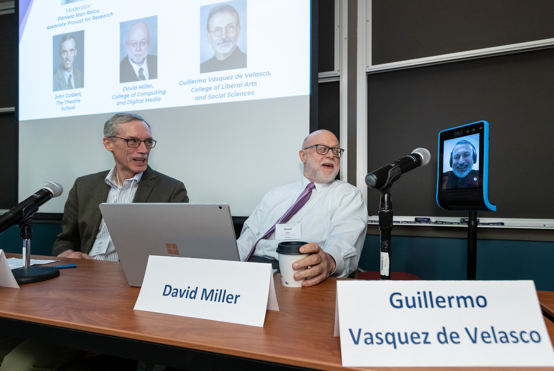 John Culbert, dean of The Theatre School, left, and David Miller, dean of the College of Computing and Digital Media, center, hosted a panel discussion along with Guillermo Vásquez de Velasco, dean of the College of Liberal Arts and Social Sciences, who participated via a telepresence robot. (DePaul University/Jeff Carrion)