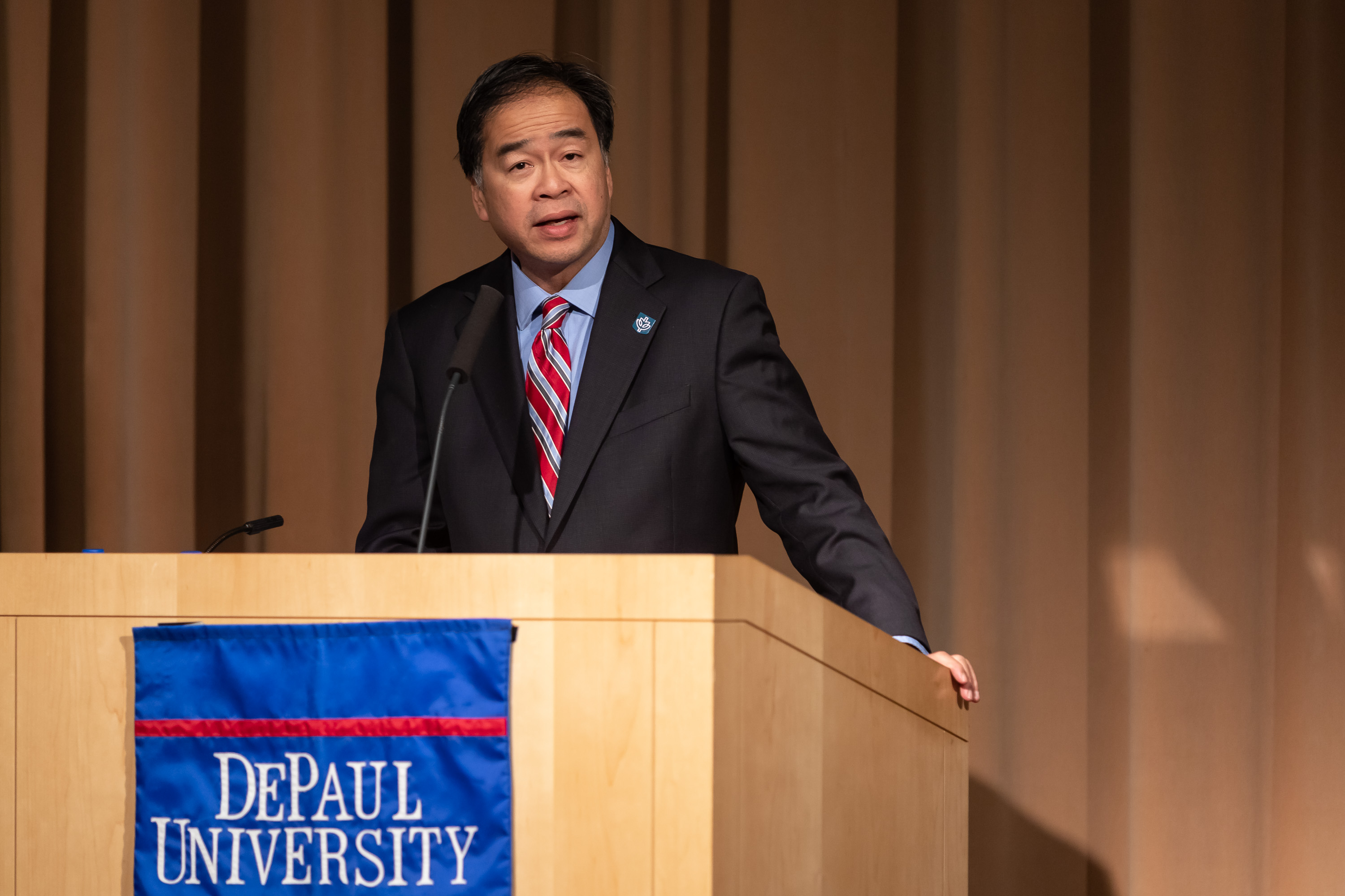 A. Gabriel Esteban, Ph.D., president of DePaul University, introduces Wes Moore during the event on March 14 in the Lincoln Park Student Center. (DePaul University/Jeff Carrion)