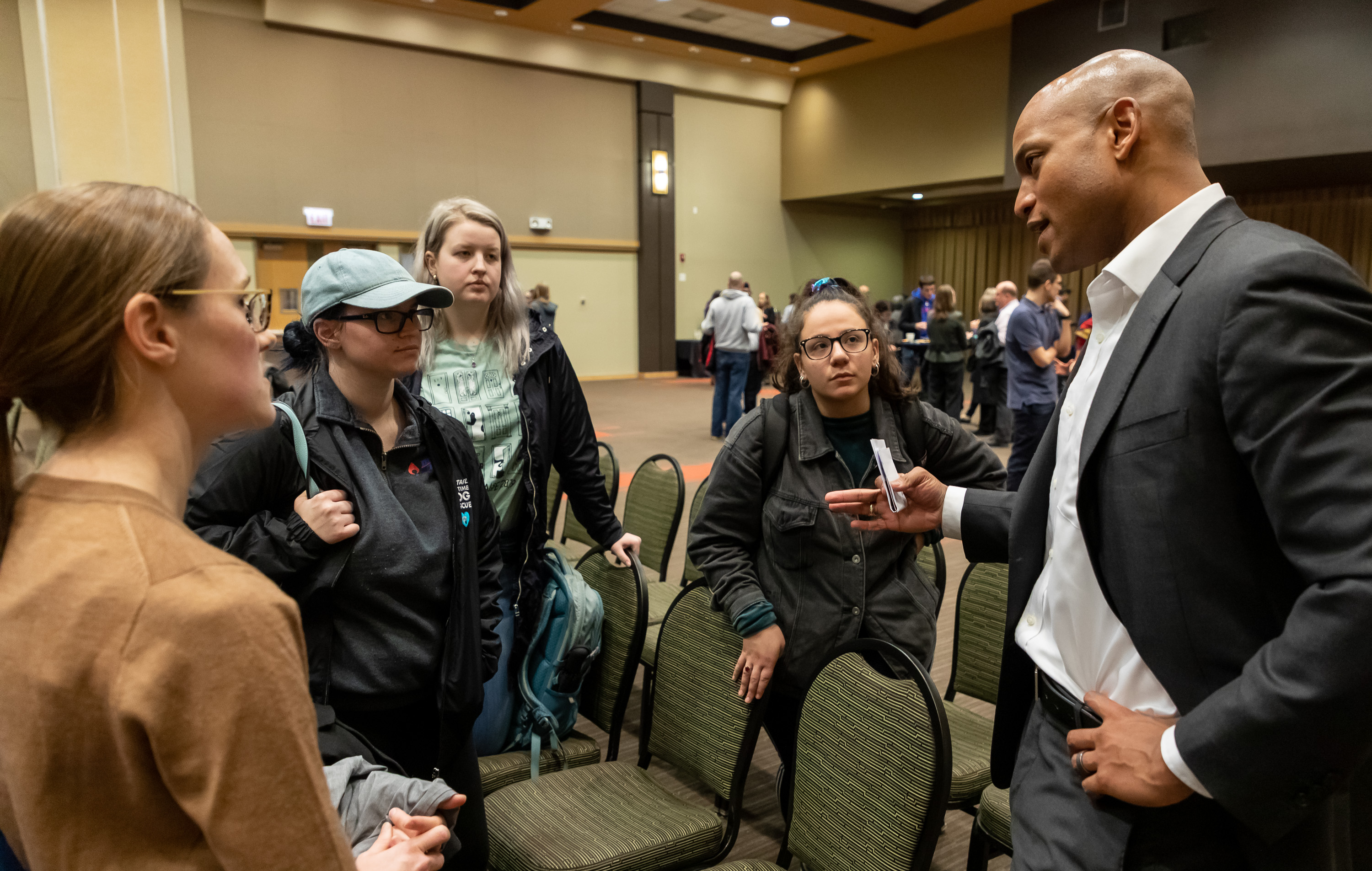 Wes Moore talks with students who attended the presentation during a reception after the event. (DePaul University/Jeff Carrion)