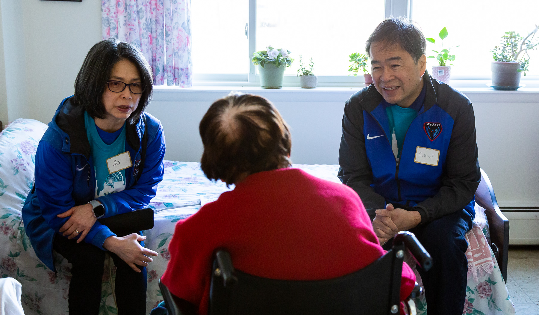 A. Gabriel Esteban, Ph.D., president of DePaul University, and his wife Josephine talk with a resident of St. Mary's Home in the Lincoln Park neighborhood. (DePaul University/Katie Donovan)