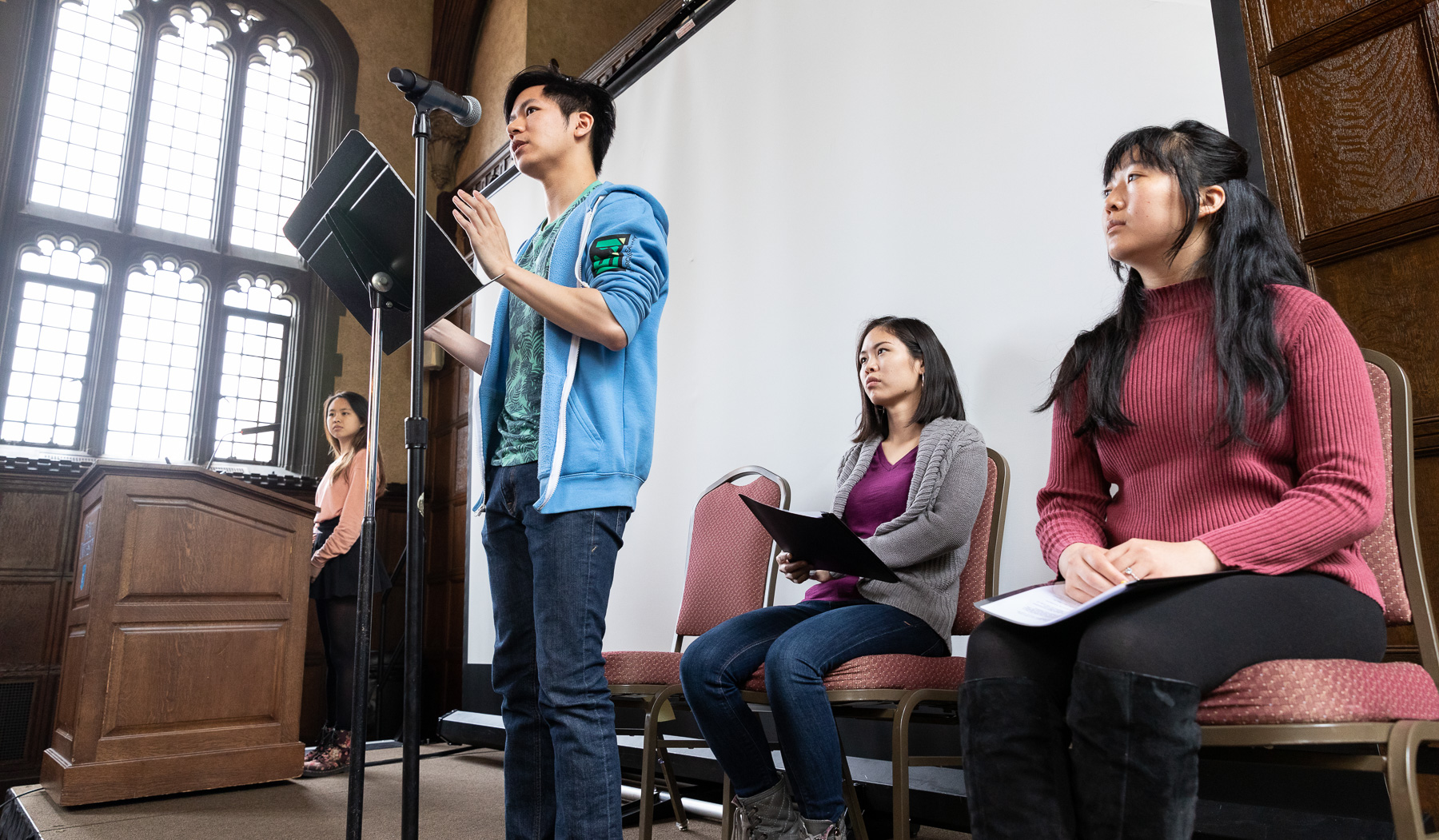 "Left to right, Isabelle Cheng, Johnny Tran, Carolyn Hu-Bradbury, and Harmony Zhang, students in The Theatre School, performed ""Asian Voices"" during the event. (DePaul University/Jeff Carrion)​"