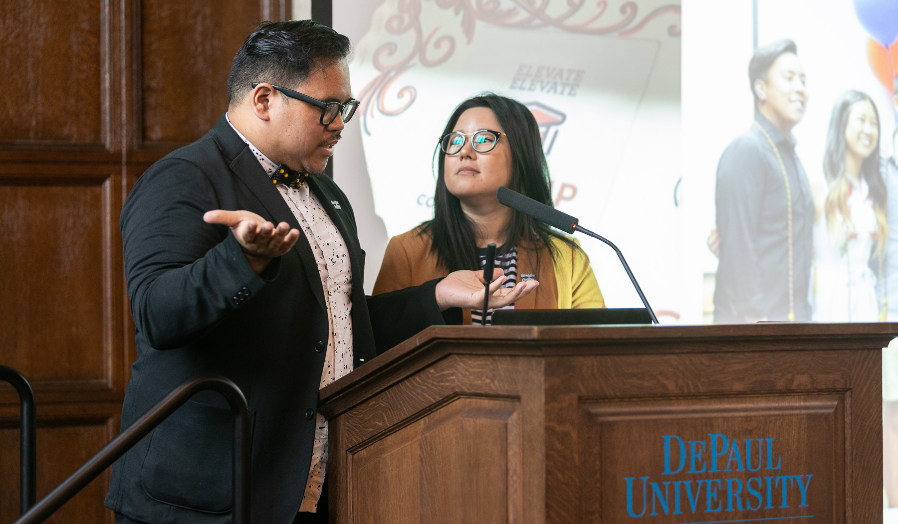 Mark Anthony Florido, assistant director, Identity Conscious Support Programs, left, and Eva Long, Asian Pacific Islander Desi American Cultural Center (APIDA) coordinator, welcomed guests to the second annual event in Cortelyou Commons. (DePaul University/Jeff Carrion)​