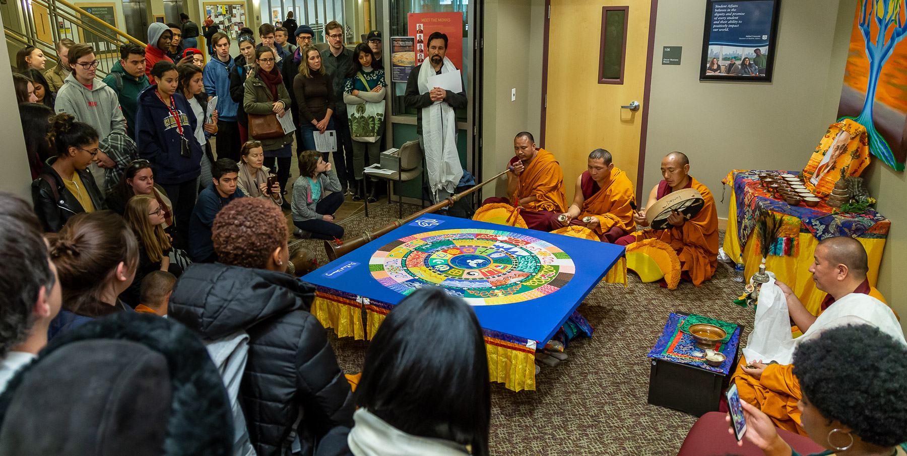 The monks perform a closing ceremony where, after a series of chants, they destroyed the mandala. (DePaul University/Jeff Carrion)
