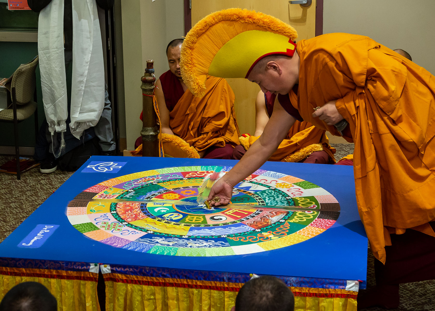 Monks customarily destroy mandalas immediatly after they are finish being created to bring fourth the underlying message that nothing is permanent. (DePaul University/Jeff Carrion)