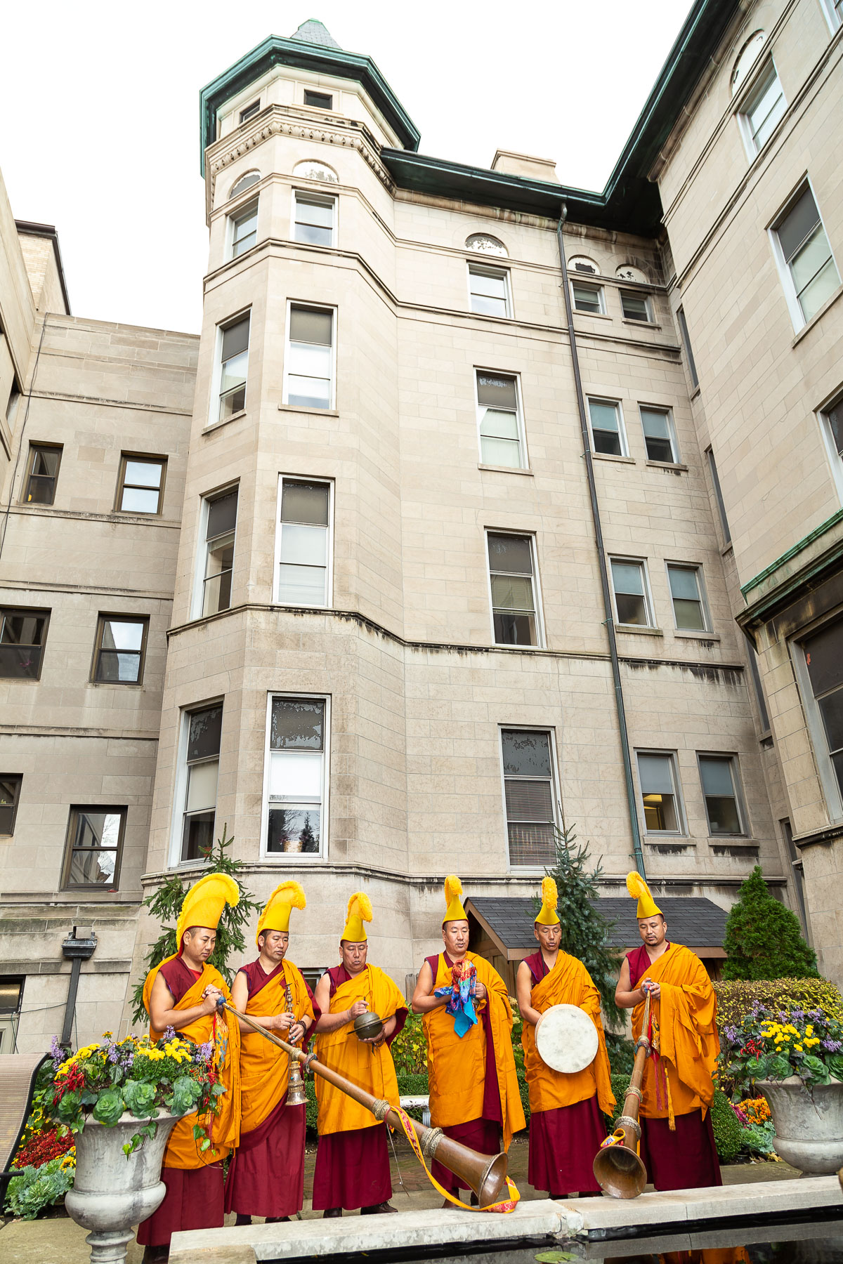 The monks continued the closing ceremony at the reflection pond in the Vincentian Residence courtyard. Their visit was sponsored by the DePaul Center for Religion, Culture and Community and the Department of Religious Studies. (DePaul University/Jeff Carrion)