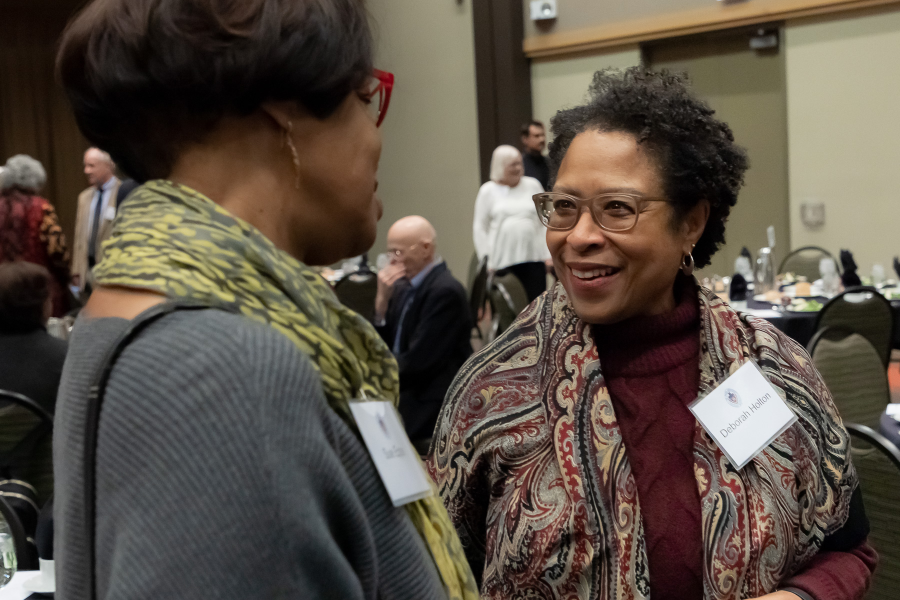 Deborah Holton, School for New Learning, right, talks with fellow honorees as DePaul University faculty and staff members are honored for their 25 years of service during a luncheon, Tuesday, Nov. 13, 2018, at the Lincoln Park Student Center. The honorees were recognized by A. Gabriel Esteban, Ph.D., president of DePaul, and will have their names added to plaques located on the Loop and Lincoln Park Campuses. (DePaul University/Jeff Carrion)