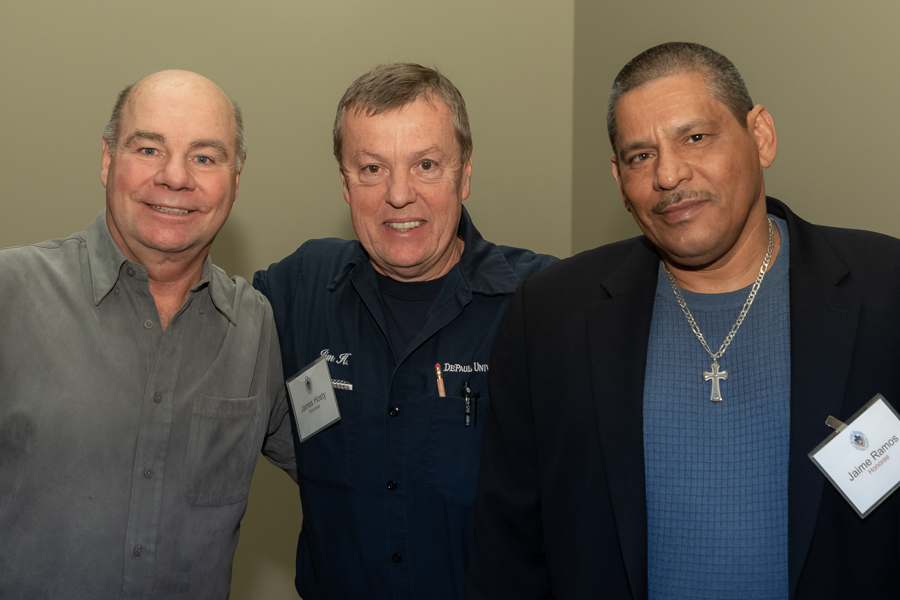 Left to right, Walter Rabenda, James Hosty, and Jaime Ramos, staff in Facility Operations, as DePaul University faculty and staff members are honored for their 25 years of service during a luncheon, Tuesday, Nov. 13, 2018, at the Lincoln Park Student Center. The honorees were recognized by A. Gabriel Esteban, Ph.D., president of DePaul, and will have their names added to plaques located on the Loop and Lincoln Park Campuses. (DePaul University/Jeff Carrion)
