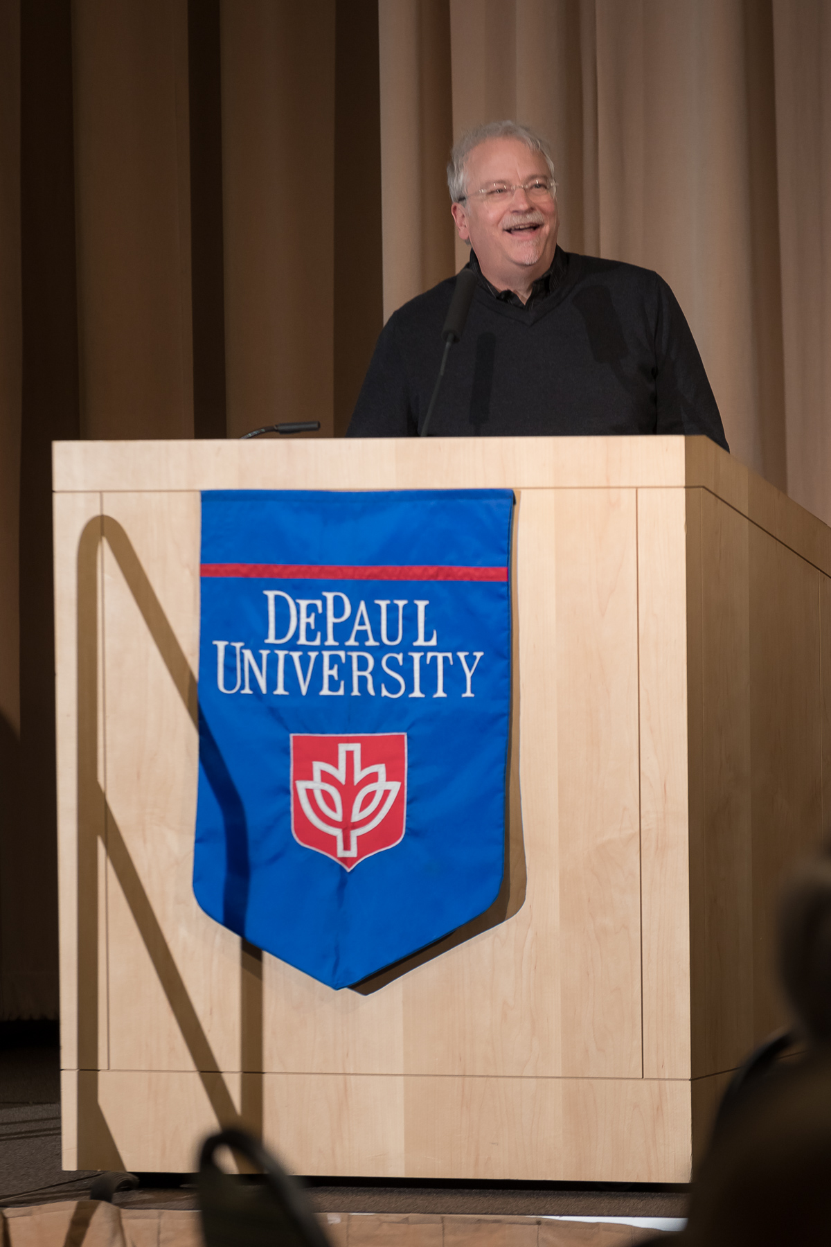 Peter Vandenberg, department chair in Writing, Rhetoric and Discourse, offers his reflections on the past 25 years as DePaul University faculty and staff members are honored for their 25 years of service during a luncheon, Tuesday, Nov. 13, 2018, at the Lincoln Park Student Center. The honorees will have their names added to plaques located on the Loop and Lincoln Park Campuses. (DePaul University/Jeff Carrion)