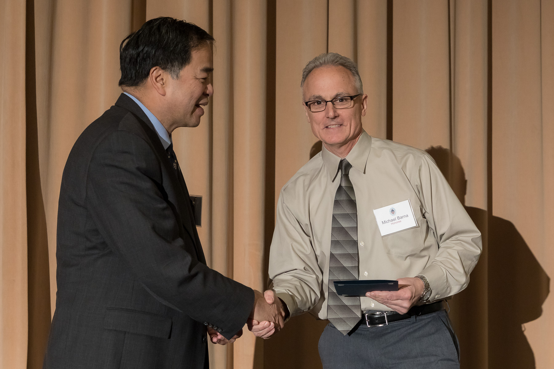 Michael Barna, right, with A. Gabriel Esteban, Ph.D., president, as faculty and staff members are inducted into DePaul University's 25 Year Club, Tuesday, Nov. 13, 2018, at the Lincoln Park Student Center. Employees celebrating their 25th work anniversary were honored at the luncheon with their colleagues and will have their names added to plaques located on the Loop and Lincoln Park Campuses. (DePaul University/Jeff Carrion)
