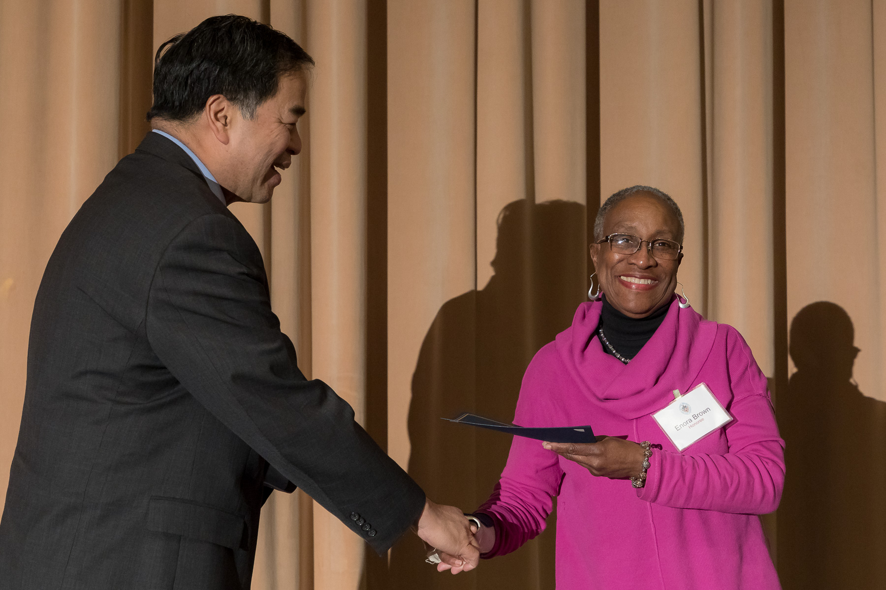 Enora Brown, right, with A. Gabriel Esteban, Ph.D., president, as faculty and staff members are inducted into DePaul University's 25 Year Club, Tuesday, Nov. 13, 2018, at the Lincoln Park Student Center. Employees celebrating their 25th work anniversary were honored at the luncheon with their colleagues and will have their names added to plaques located on the Loop and Lincoln Park Campuses. (DePaul University/Jeff Carrion)