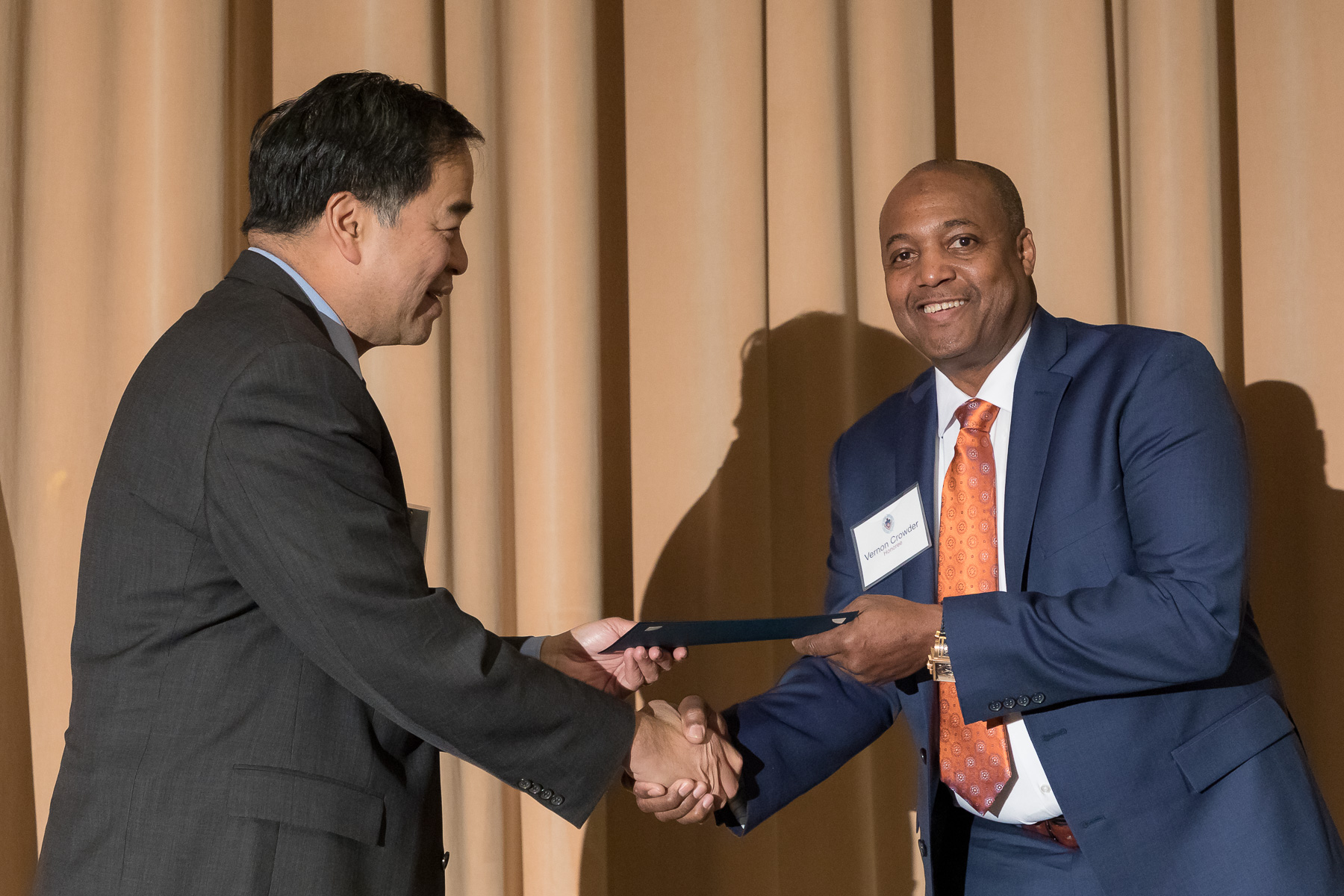 Vernon Crowder, right, with A. Gabriel Esteban, Ph.D., president, as faculty and staff members are inducted into DePaul University's 25 Year Club, Tuesday, Nov. 13, 2018, at the Lincoln Park Student Center. Employees celebrating their 25th work anniversary were honored at the luncheon with their colleagues and will have their names added to plaques located on the Loop and Lincoln Park Campuses. (DePaul University/Jeff Carrion)