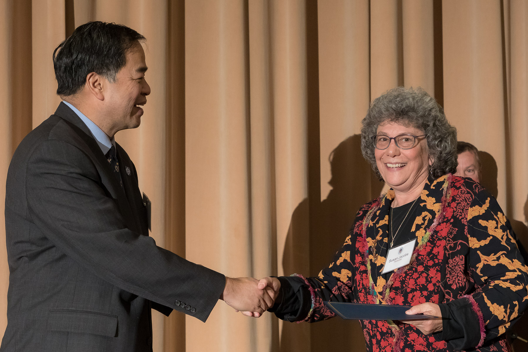 Susan Jacobs, right, with A. Gabriel Esteban, Ph.D., president, as faculty and staff members are inducted into DePaul University's 25 Year Club, Tuesday, Nov. 13, 2018, at the Lincoln Park Student Center. Employees celebrating their 25th work anniversary were honored at the luncheon with their colleagues and will have their names added to plaques located on the Loop and Lincoln Park Campuses. (DePaul University/Jeff Carrion)