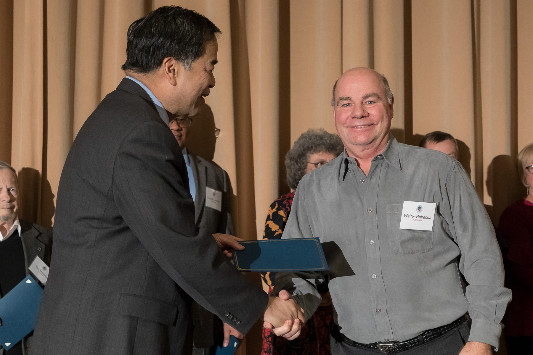 Walter Rabenda, right, with A. Gabriel Esteban, Ph.D., president, as faculty and staff members are inducted into DePaul University's 25 Year Club, Tuesday, Nov. 13, 2018, at the Lincoln Park Student Center. Employees celebrating their 25th work anniversary were honored at the luncheon with their colleagues and will have their names added to plaques located on the Loop and Lincoln Park Campuses. (DePaul University/Jeff Carrion)