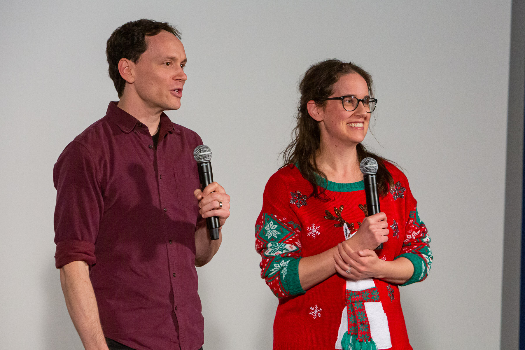 "Devin Bell, left, and Meghann Artes, associate professors in the School of Cinematic Arts, answer questions from guests after presenting the release of ""Merry Christmas from DePaul"" for the first time. (DePaul University/Randall Spriggs)"
