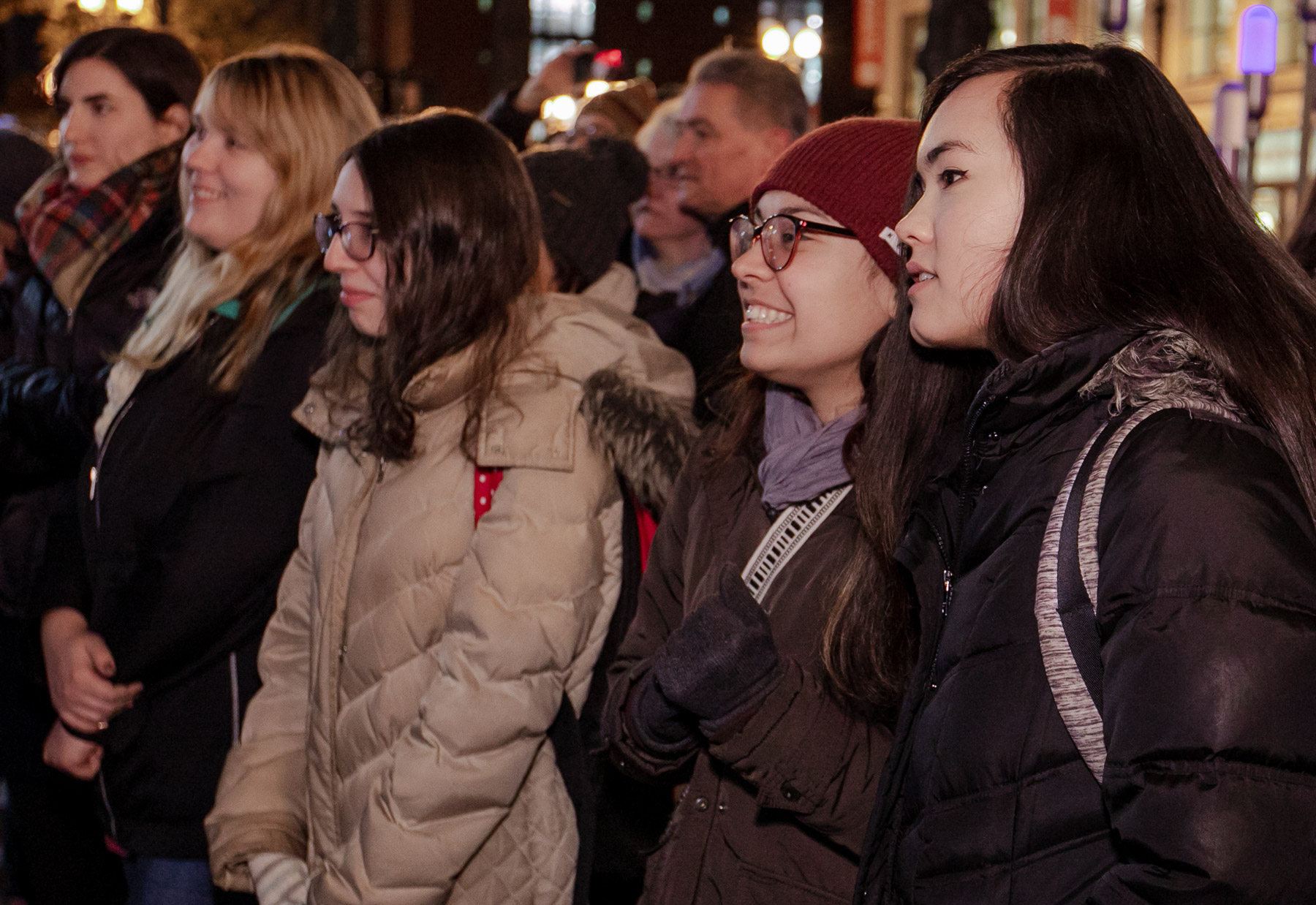 Students, faculty and staff watch the stop-motion film after its debut on State Street. The Merry Christmas from DePaul window utilizes state-of-the-art technology to build an imaginative, 3-D experience. (DePaul University/Randall Spriggs)