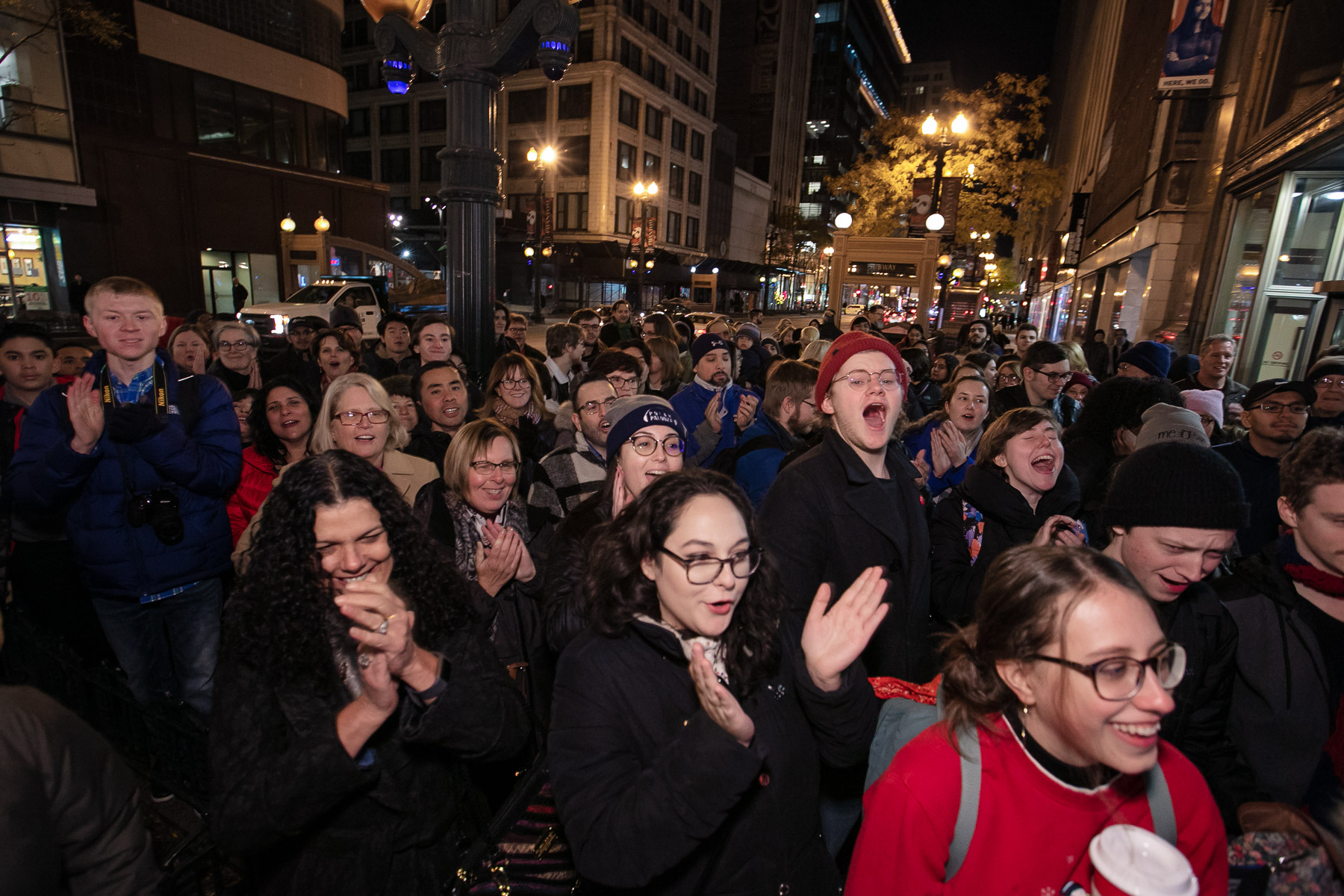 A crowd of DePaul faculty, staff, students and other onlookers cheer for the stop-motion film and display. More than 30 students worked for more than a year on the film. (DePaul University/Randall Spriggs)