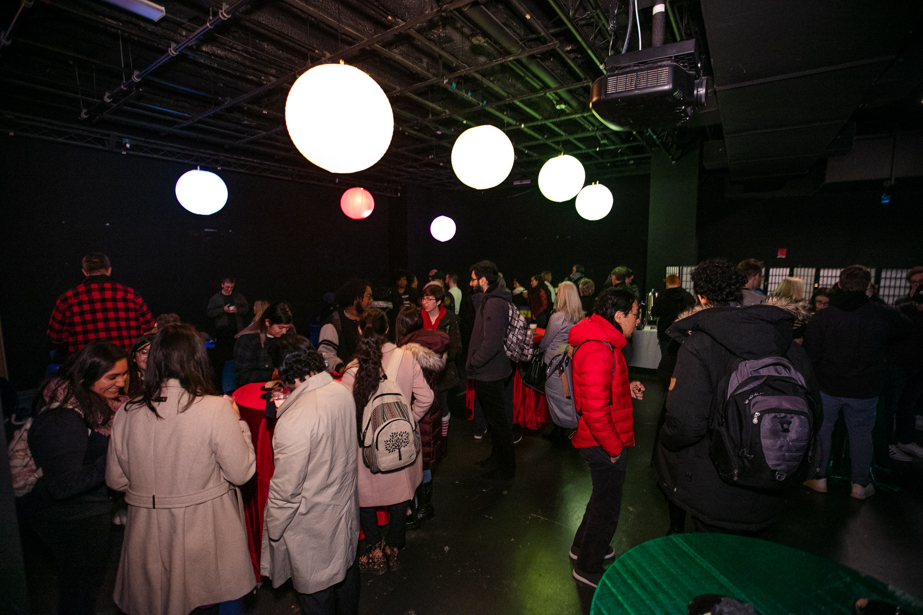 The DePaul community, family and guests were invited for a post-unveiling reception which included hot chocolate and holiday treats on the Digital Cinema Stage. (DePaul University/Randall Spriggs)