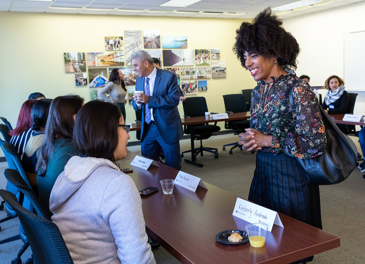 Sybil Madison, deputy mayor for education and human services, city of Chicago, meets with students enrolled in the DePaul Harold Washington Academy. (DePaul University/Jeff Carrion)