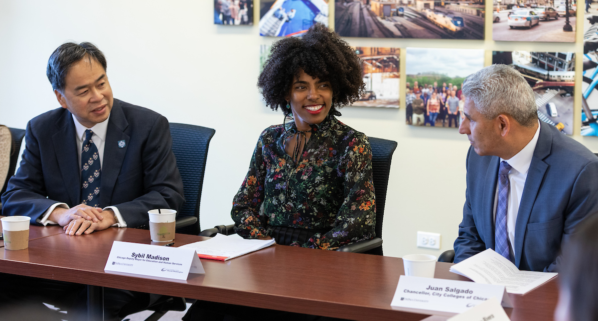 Left to right, A. Gabriel Esteban, Ph.D., president of DePaul; Sybil Madison, deputy mayor for education and human services, city of Chicago; and Juan Salgado, chancellor, City Colleges of Chicago, meet with students enrolled in the DePaul Harold Washington Academy