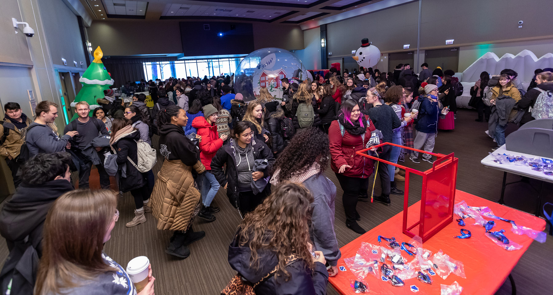 DePaul students take part in the many available crafts, games and activities during the second-annual Ugly Sweater Party in the Lincoln Park Student Center. (DePaul University/Jeff Carrion)