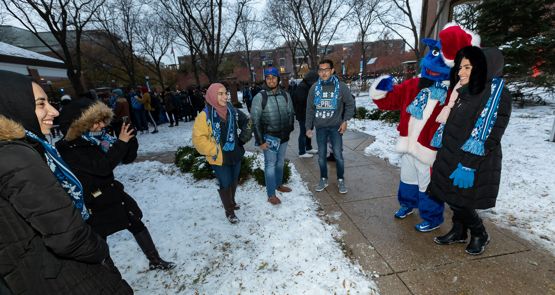Students grab pictures with DIBS before the Tree Lighting Ceremony. (DePaul University/Jeff Carrion)