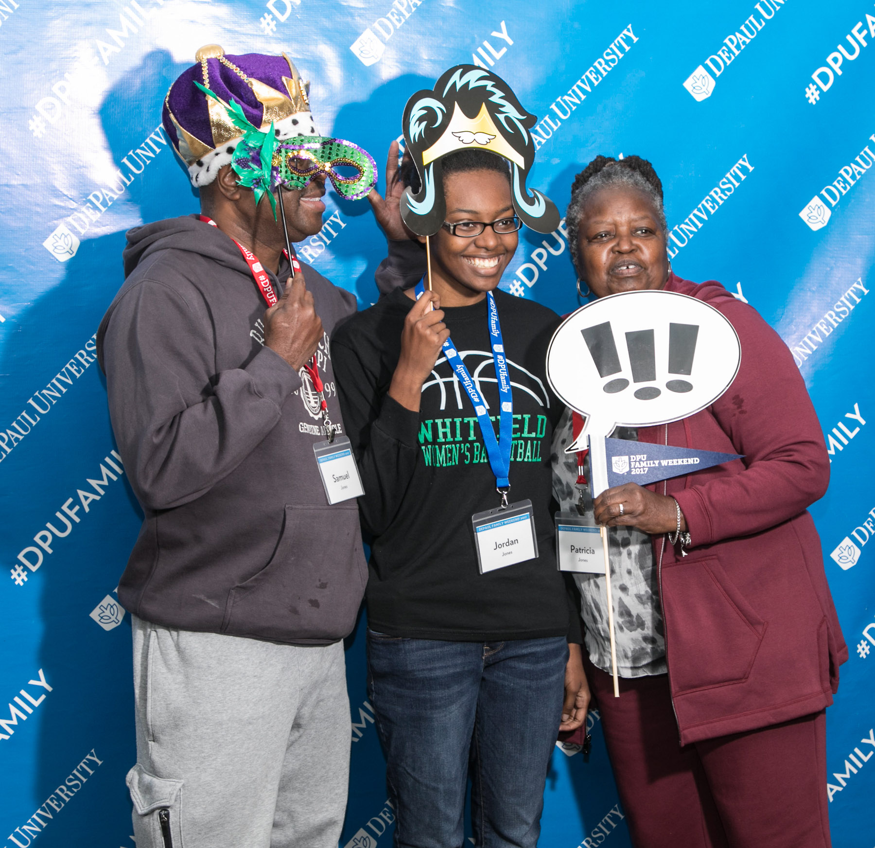 Sam, Jordan and Patricia Jones, left to right, pose for a photo as DePaul students and family members arrive at the Family Weekend Kickoff celebration. (DePaul University/Jamie Moncrief)