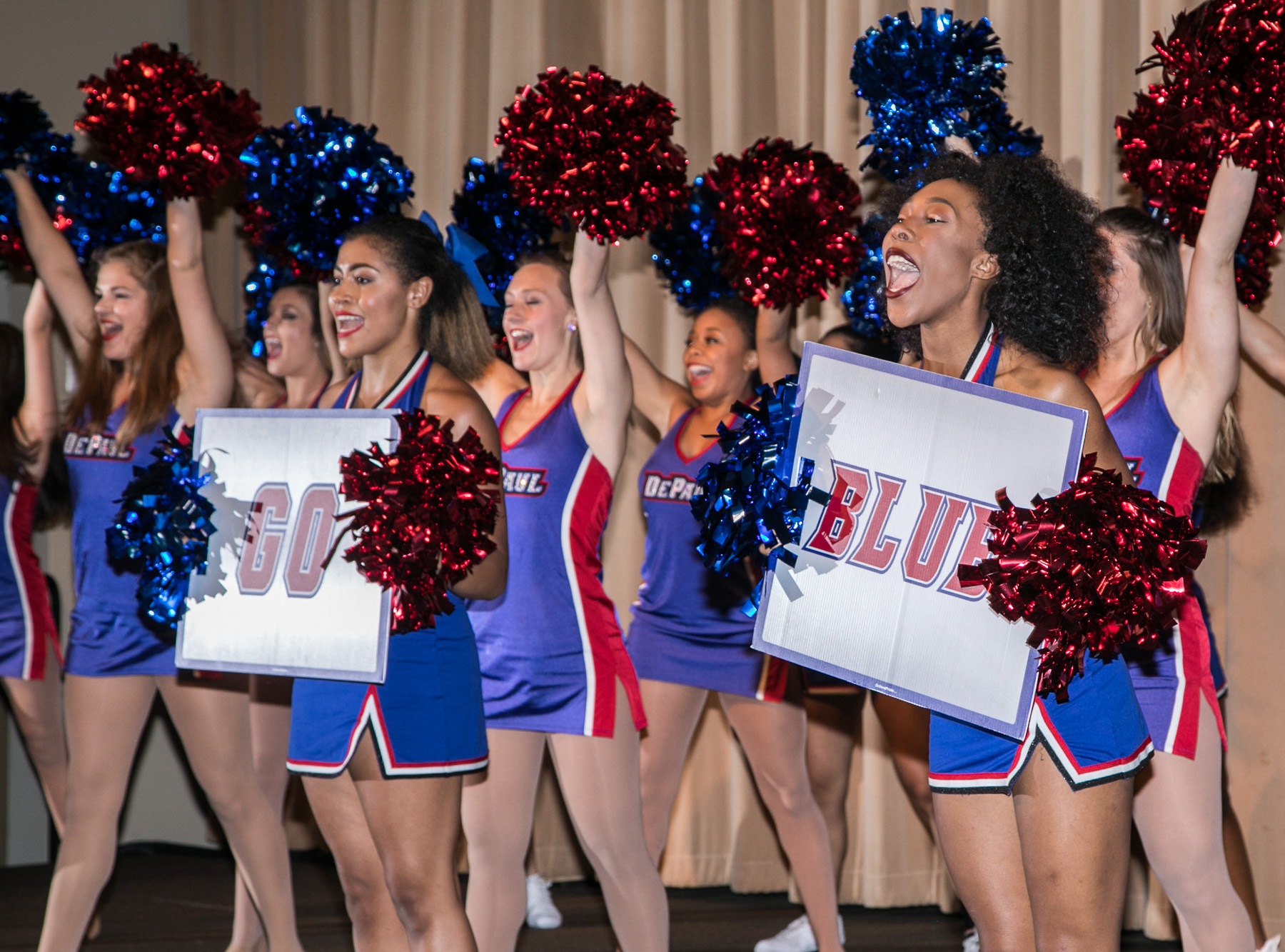 Members of the DePaul University Dance and Cheer Teams warm up the crowd during the Family Weekend Kickoff party. (DePaul University/Jamie Moncrief)