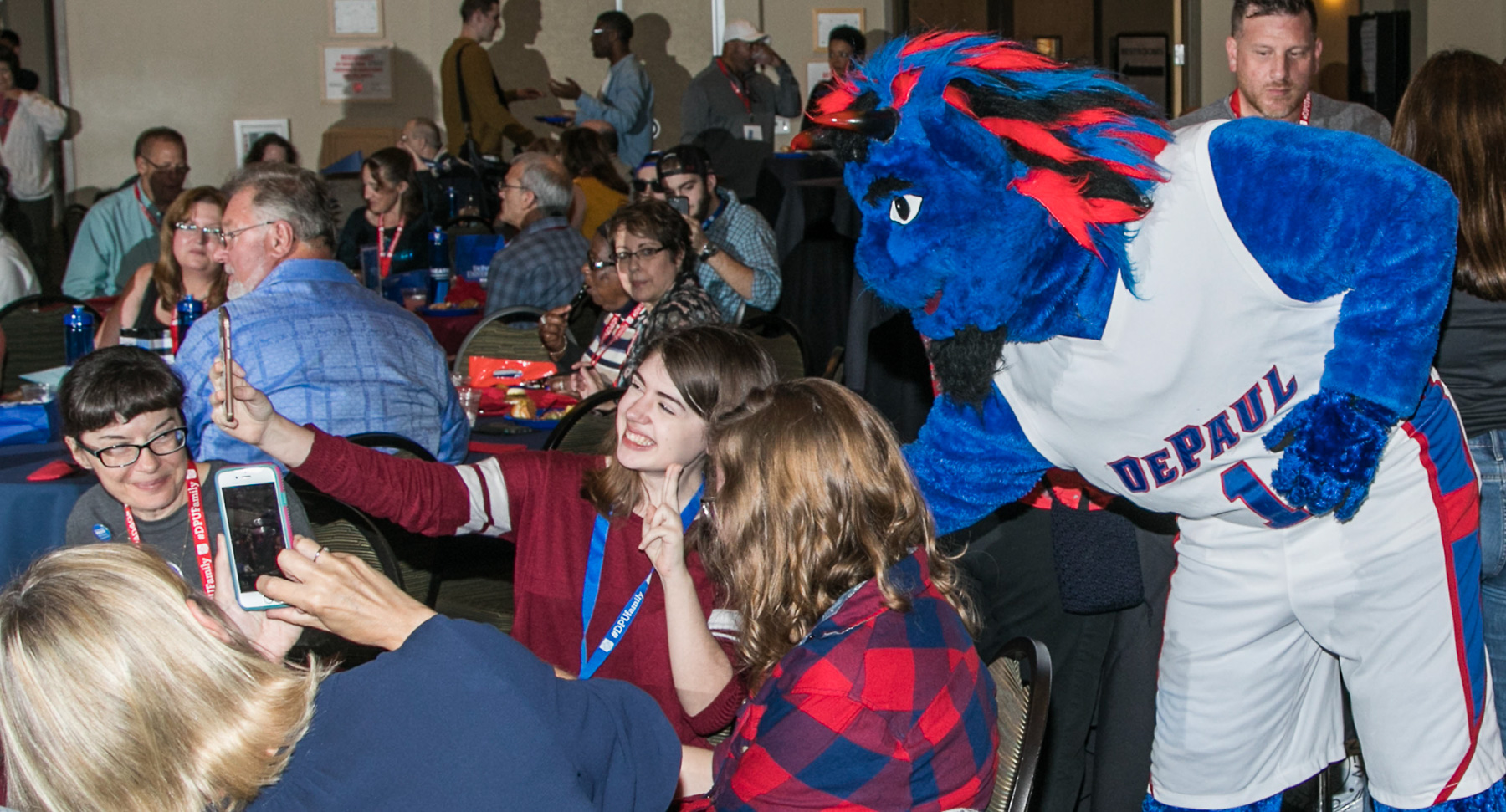 DIBS poses with guests at the Family Weekend Kickoff celebration. Student groups performed for the guests during a buffet dinner that started the weekend of festivities. (DePaul University/Jamie Moncrief)