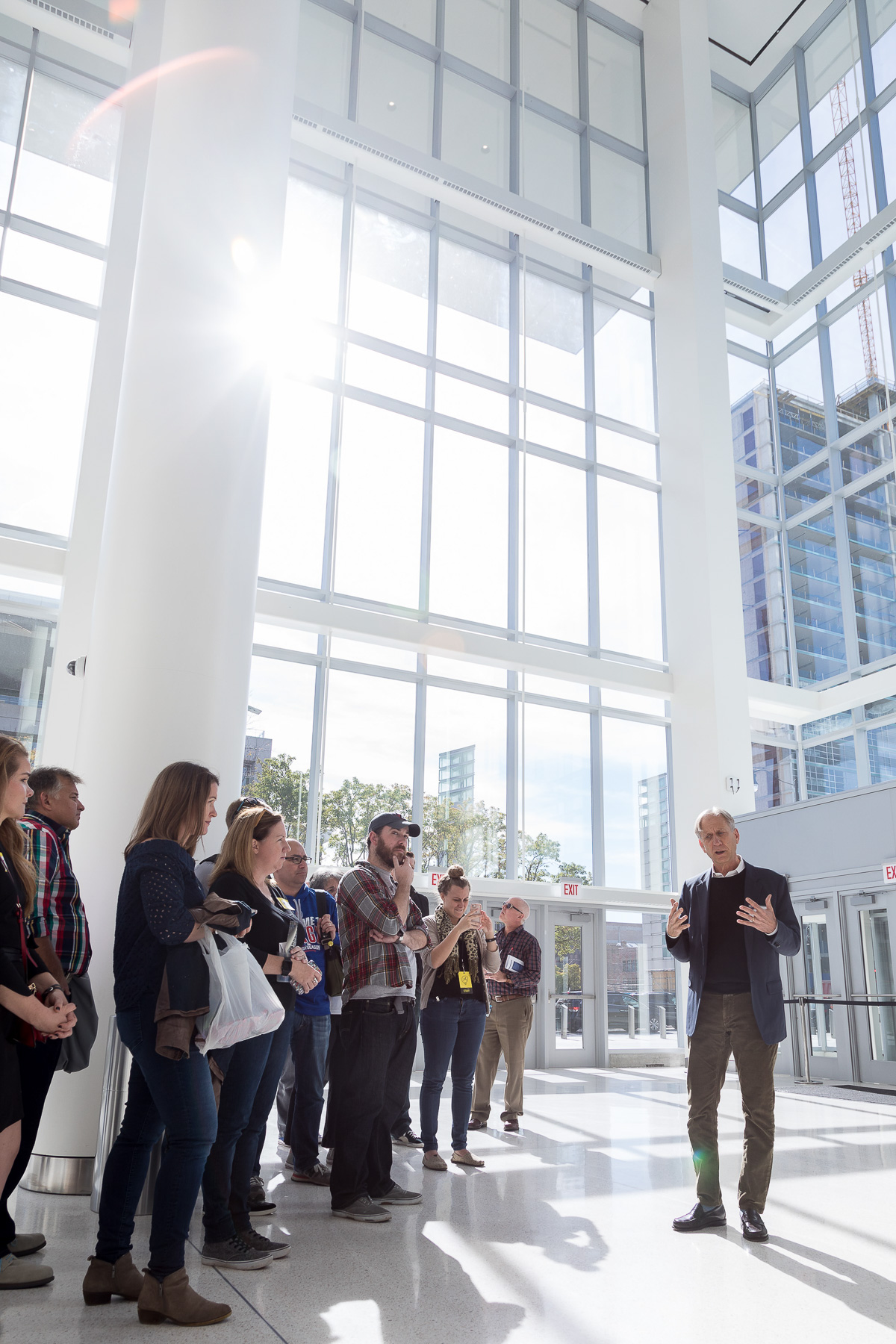 Mitchell Hirsch, principal architect for Pelli Clarke Pelli Architects, speaks to attendees in the atrium of Wintrust Arena during a sneak peek tour. (DePaul University/Jeff Carrion)