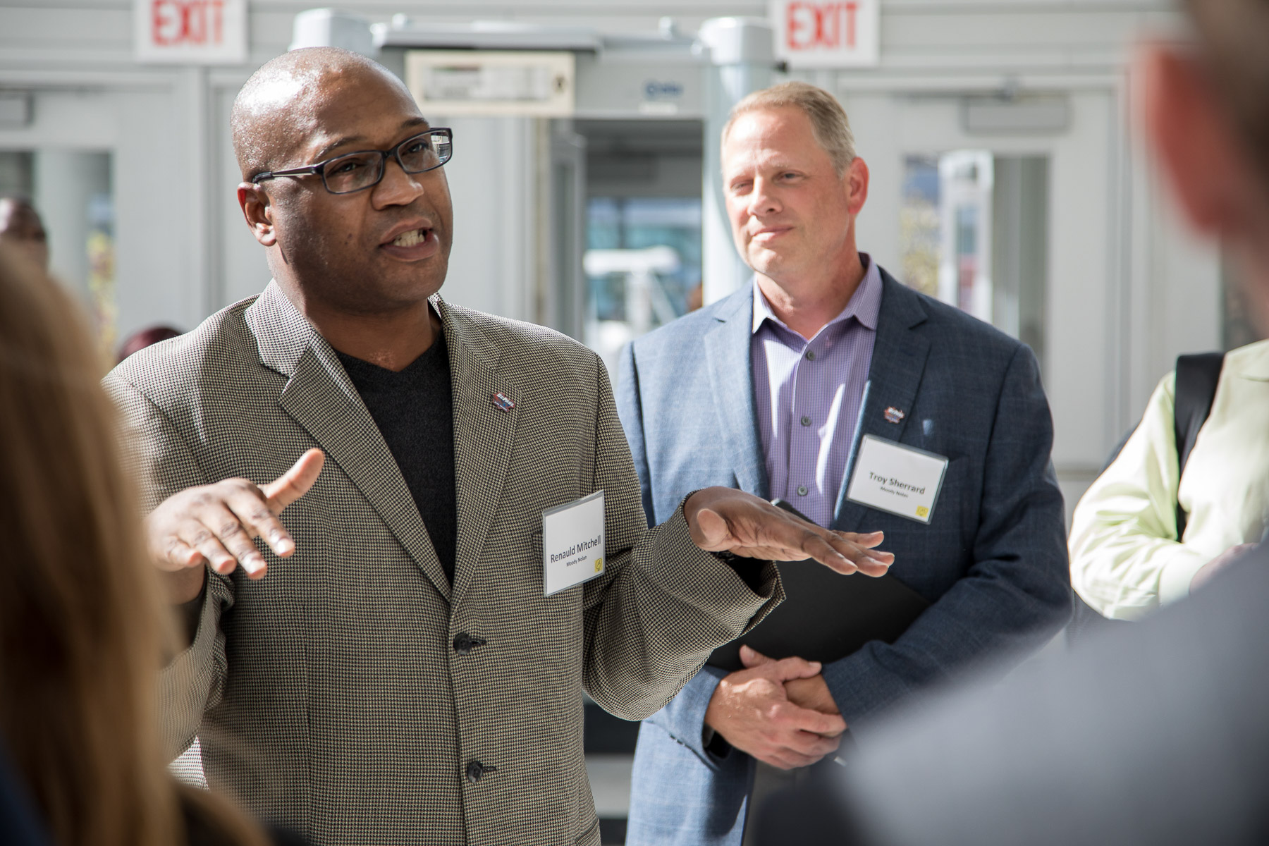 Renauld Mitchell, partner and director of operations in Chicago and Washington for Moody Nolan, told attendees about how the arena was designed and constructed. He was joined by Troy Sherrard (right) from Moody Nolan. (DePaul University/Jeff Carrion)