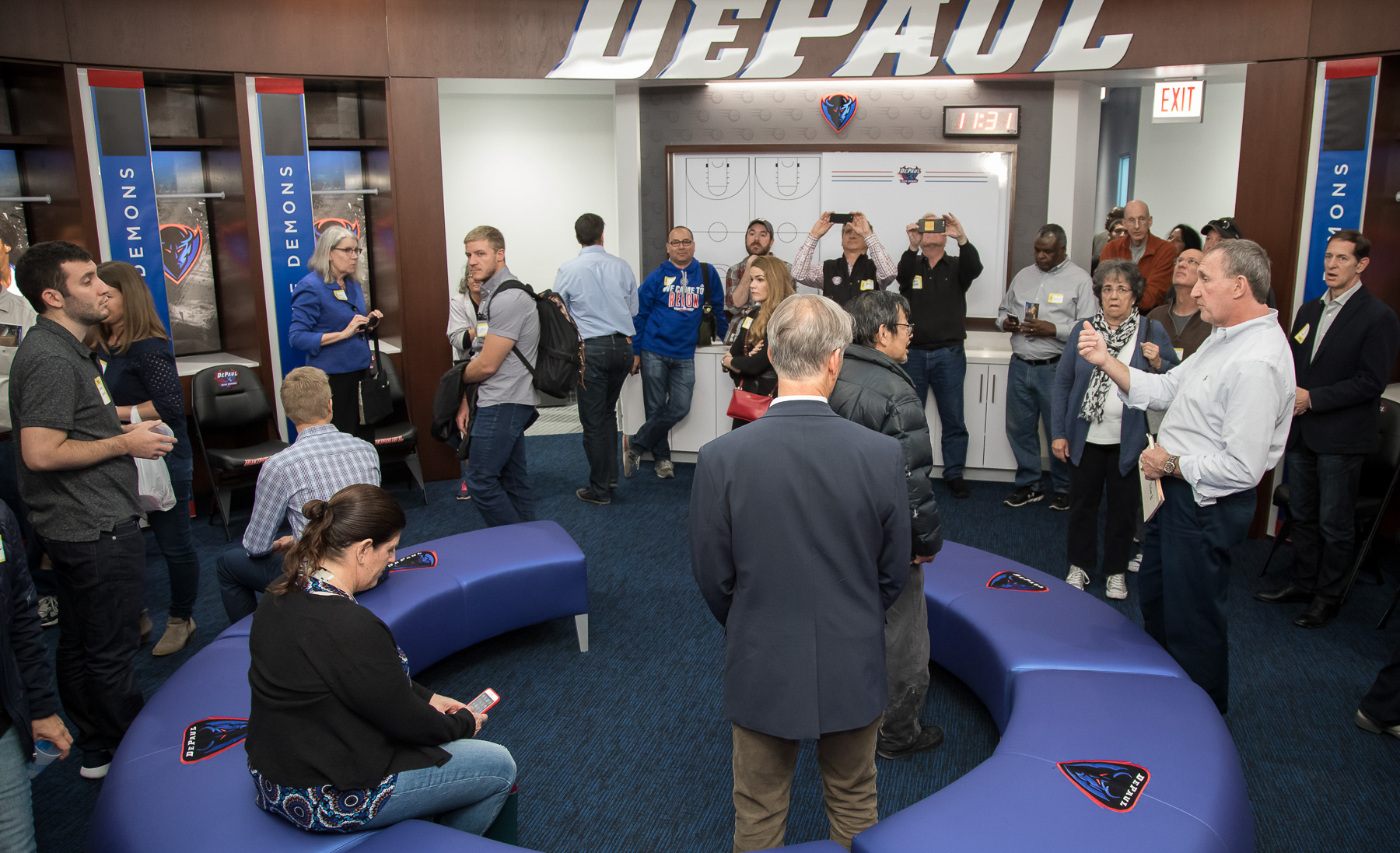 Attendees explore the women's basketball locker room during a sneak peek of Wintrust Arena, the new home of the DePaul Blue Demons basketball. (DePaul University/Jeff Carrion)