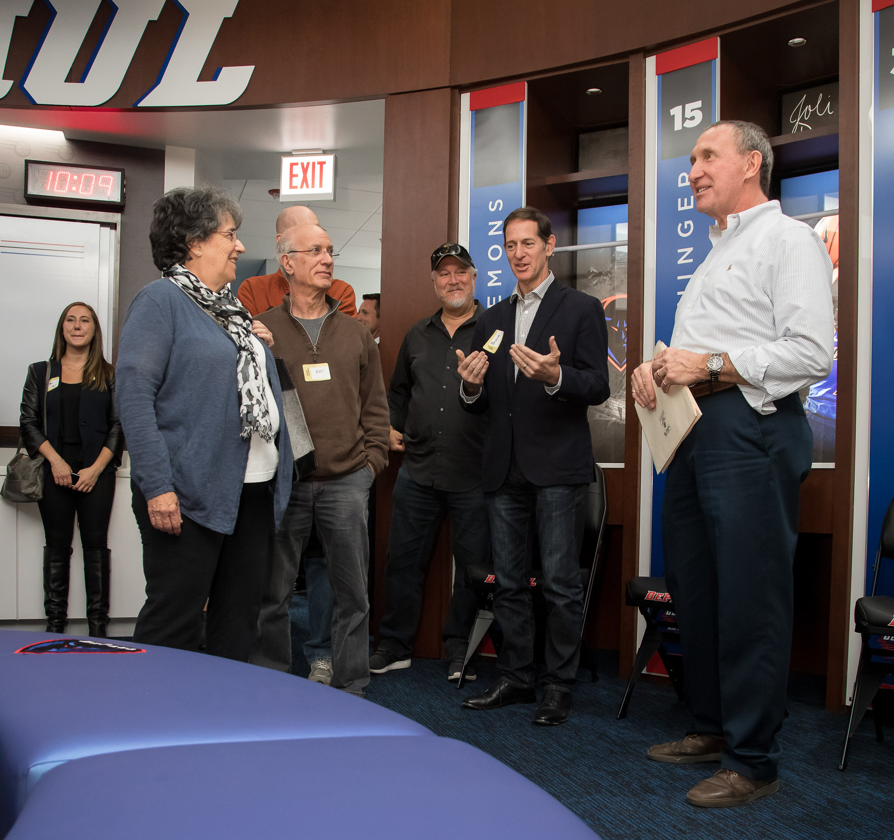 Bob Janis, vice president of facility operations, far right, answers questions about the women's basketball locker room. (DePaul University/Jeff Carrion)