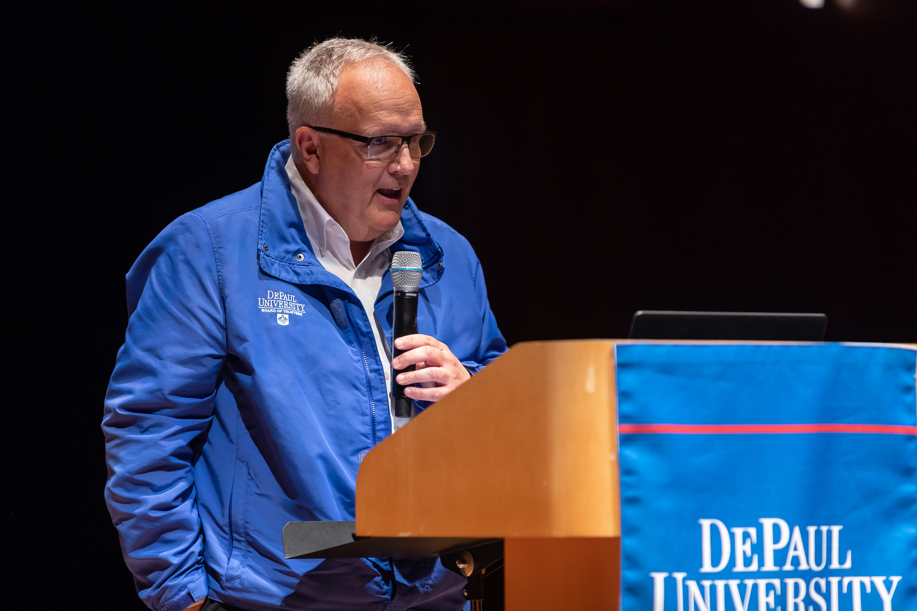 The Rev. Edward R. Udovic, C.M., secretary of the university, gives an invocation during the State of the University address. (DePaul University/Jeff Carrion)​