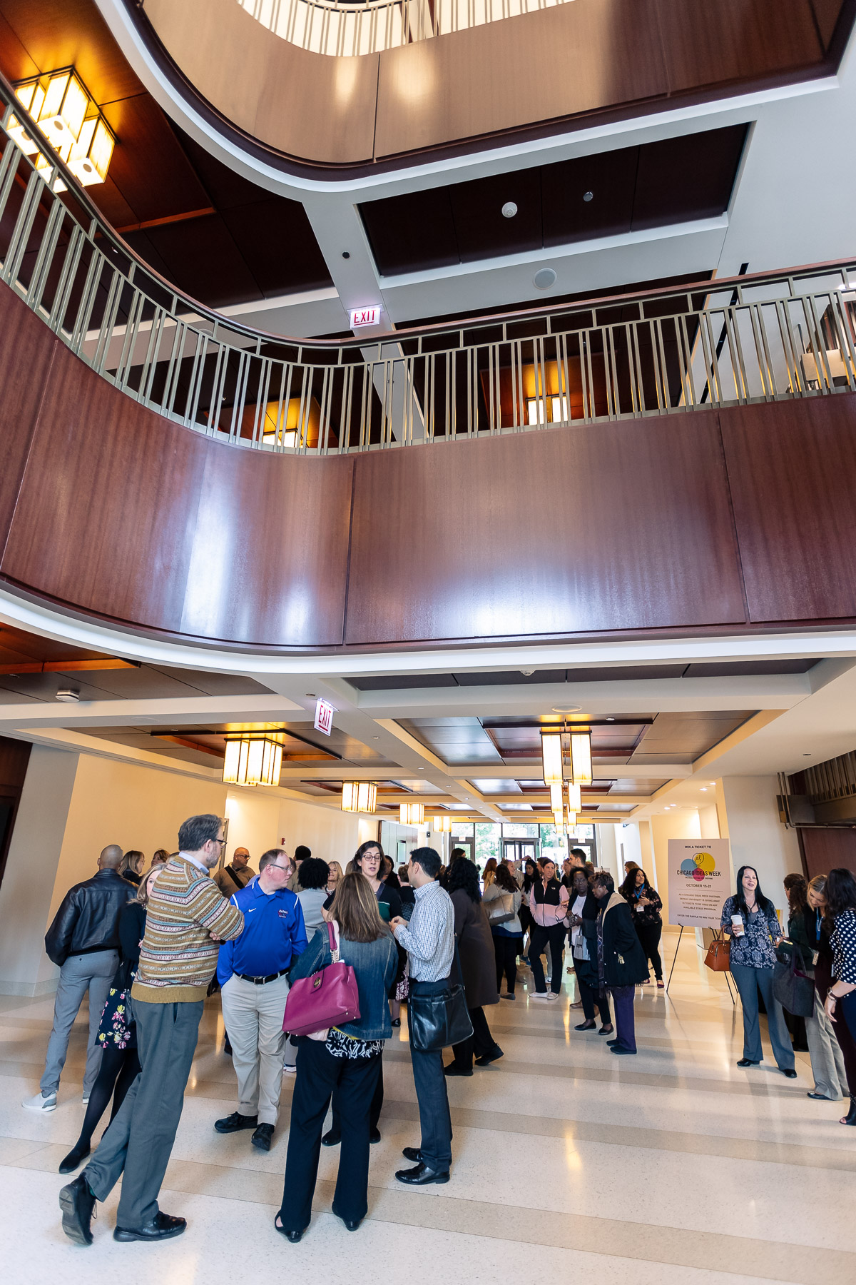 DePaul faculty and staff wait to enter the Holtschneider Performance Center inside the School of Music before the State of the University Address. (DePaul University/Jeff Carrion)​