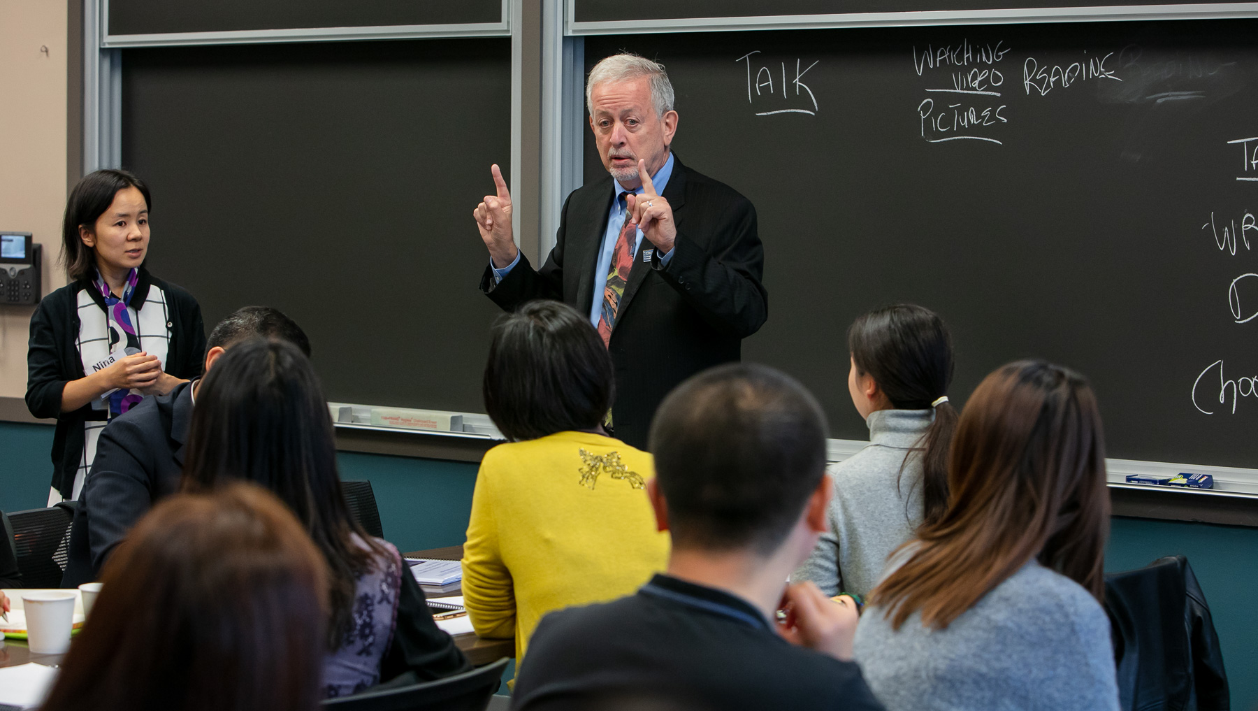 Paul Zionts demonstrates a learning technique that teachers from Beijing, China can implement during their own class lectures. (DePaul University/Randall Spriggs)