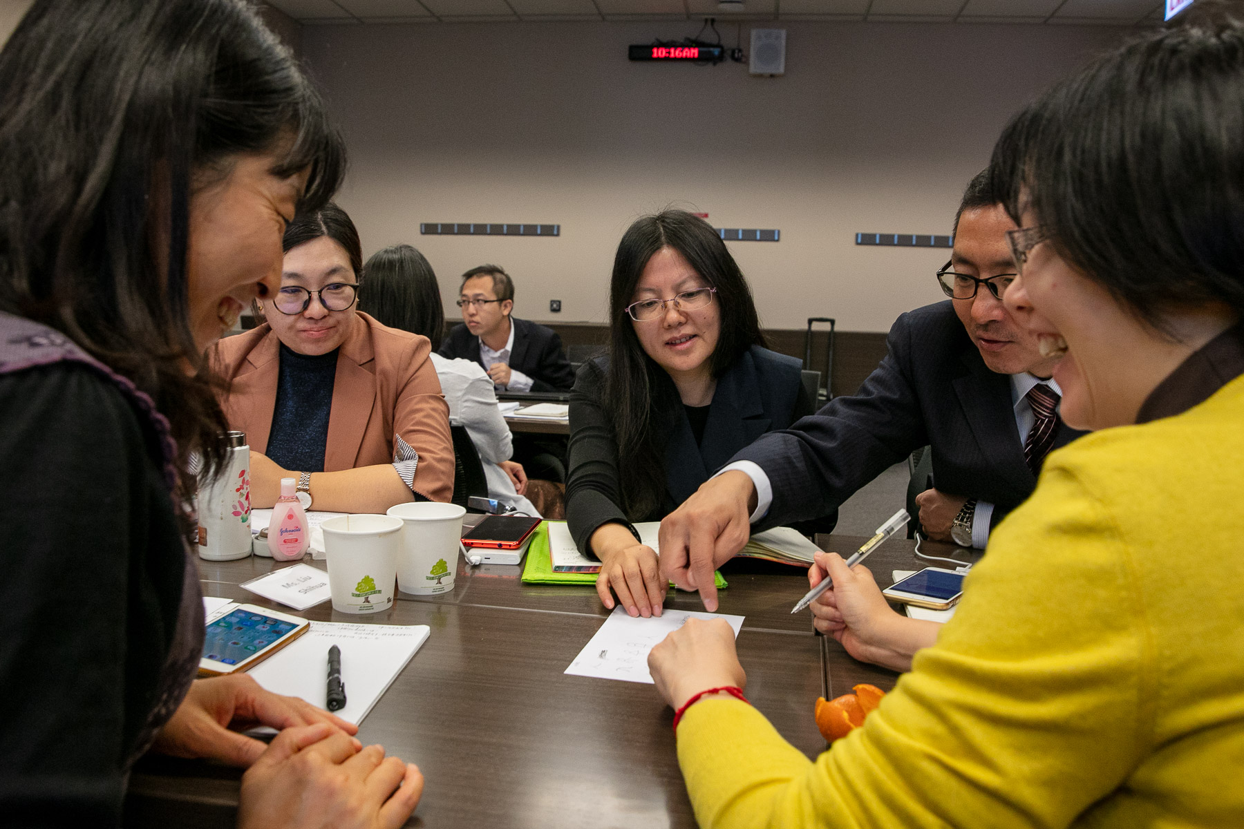 Teachers from Beijing, China, collaborate on various teaching styles during a group task. (DePaul University/Randall Spriggs)